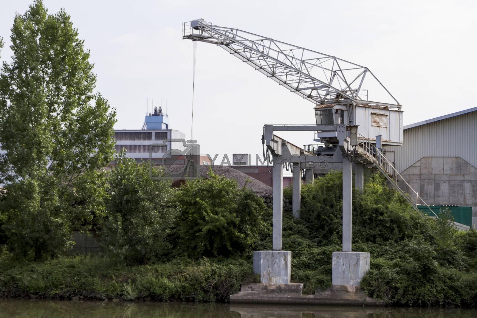 small, old dockside crane at river Neckar in germany