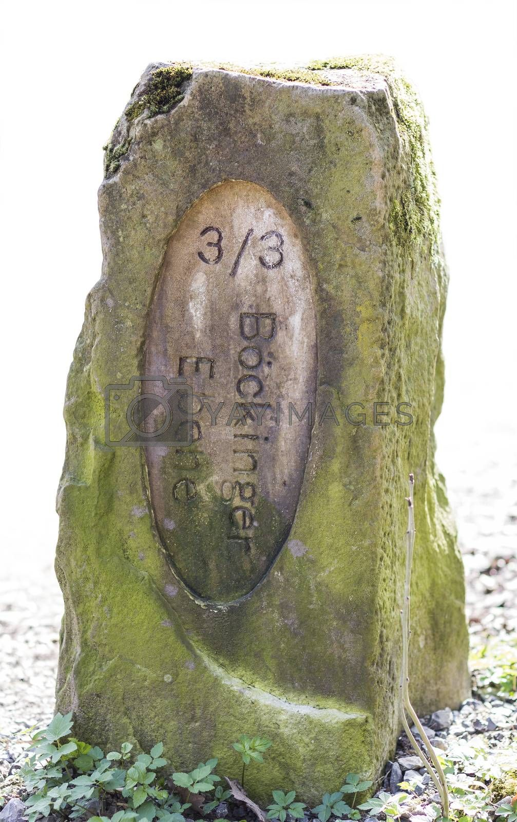 Royalty free image of old boundary stone in white background by gewoldi