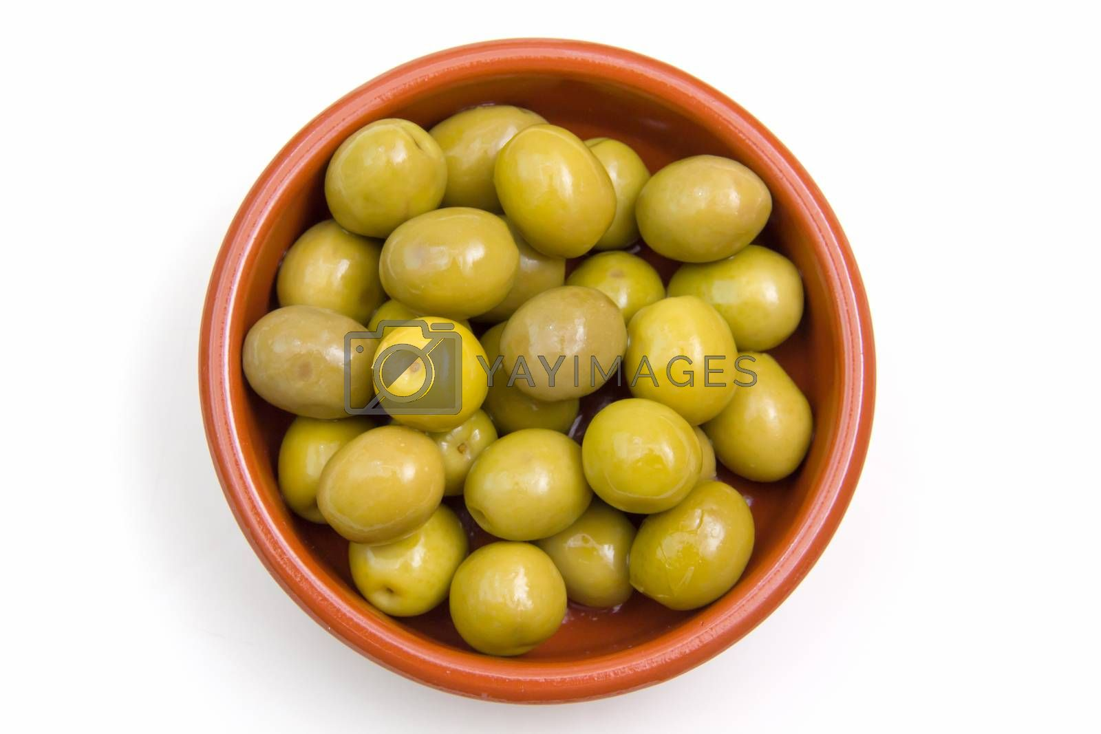 Olives on rustic bowl top view on white background