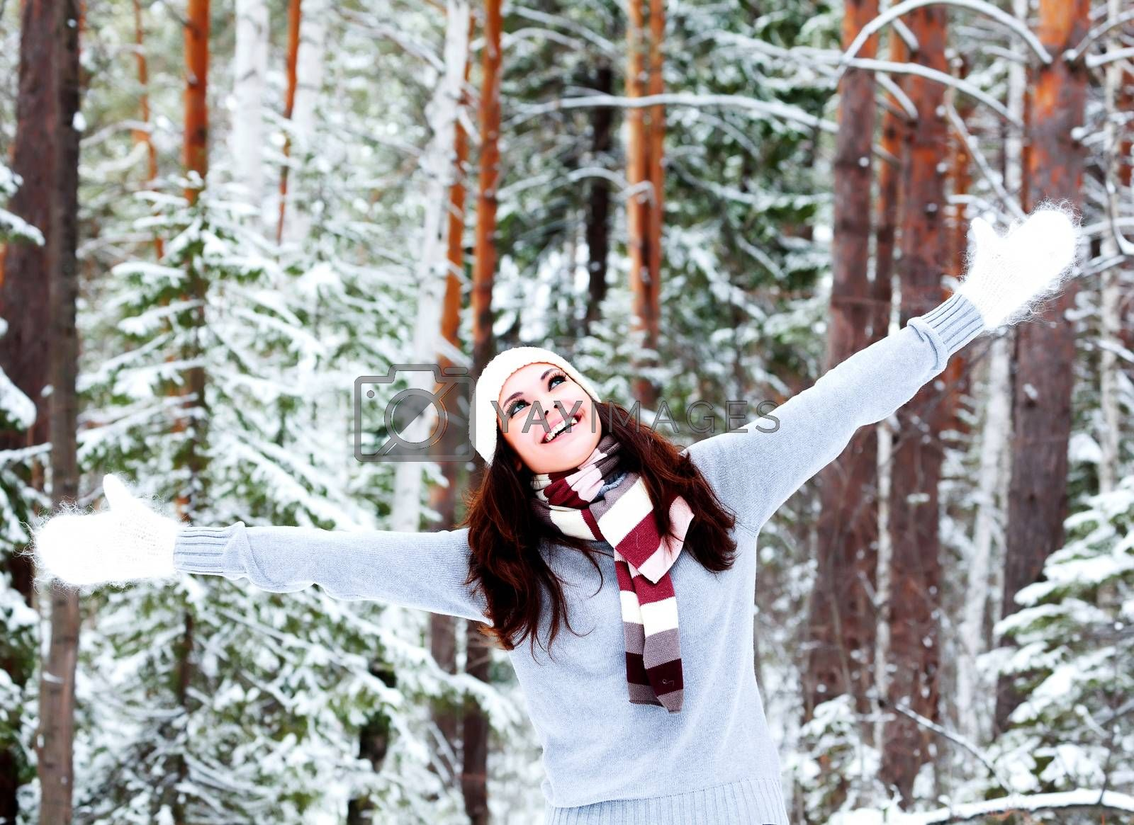 Happy woman in a winter forest.