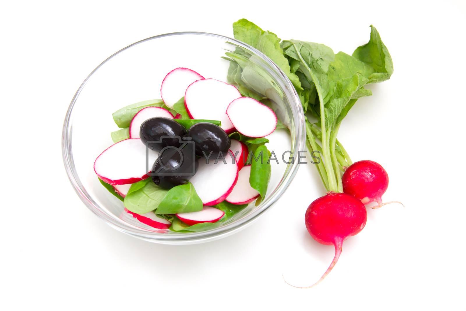 Salad radishes in bowl on white background
