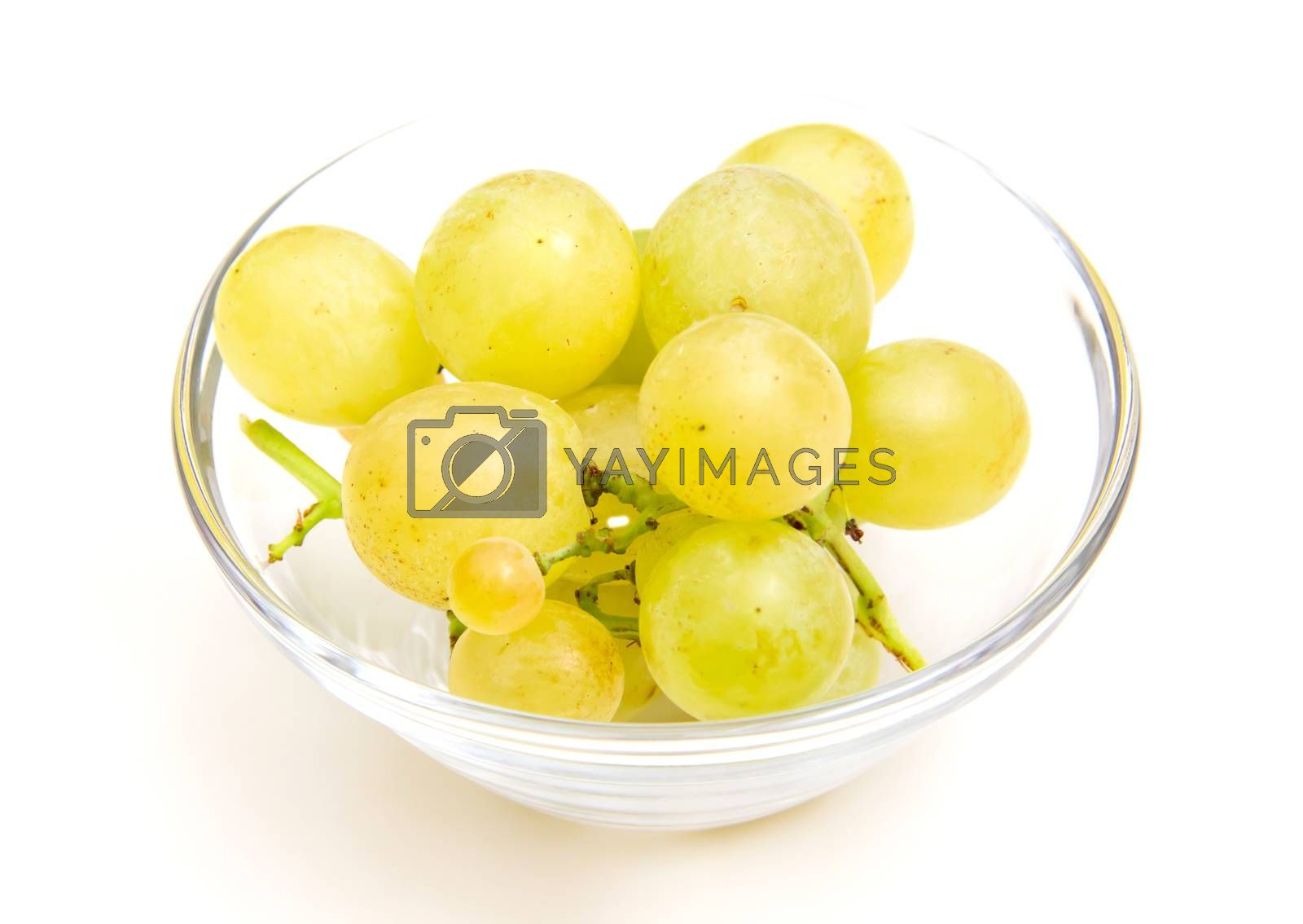 Grapes on a bowl close up view on white background
