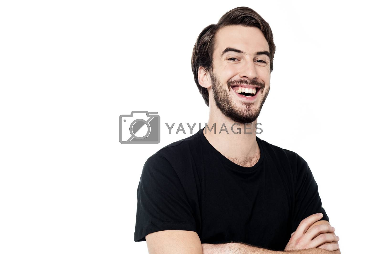 Happy young man posing to camera over white