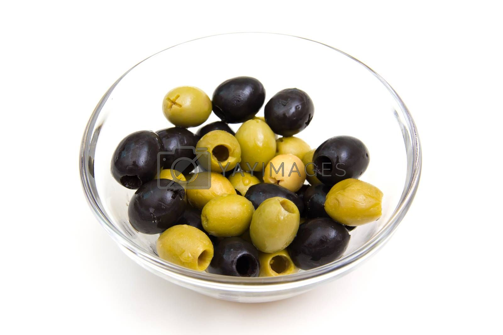 Green and black olives on bowl on white background