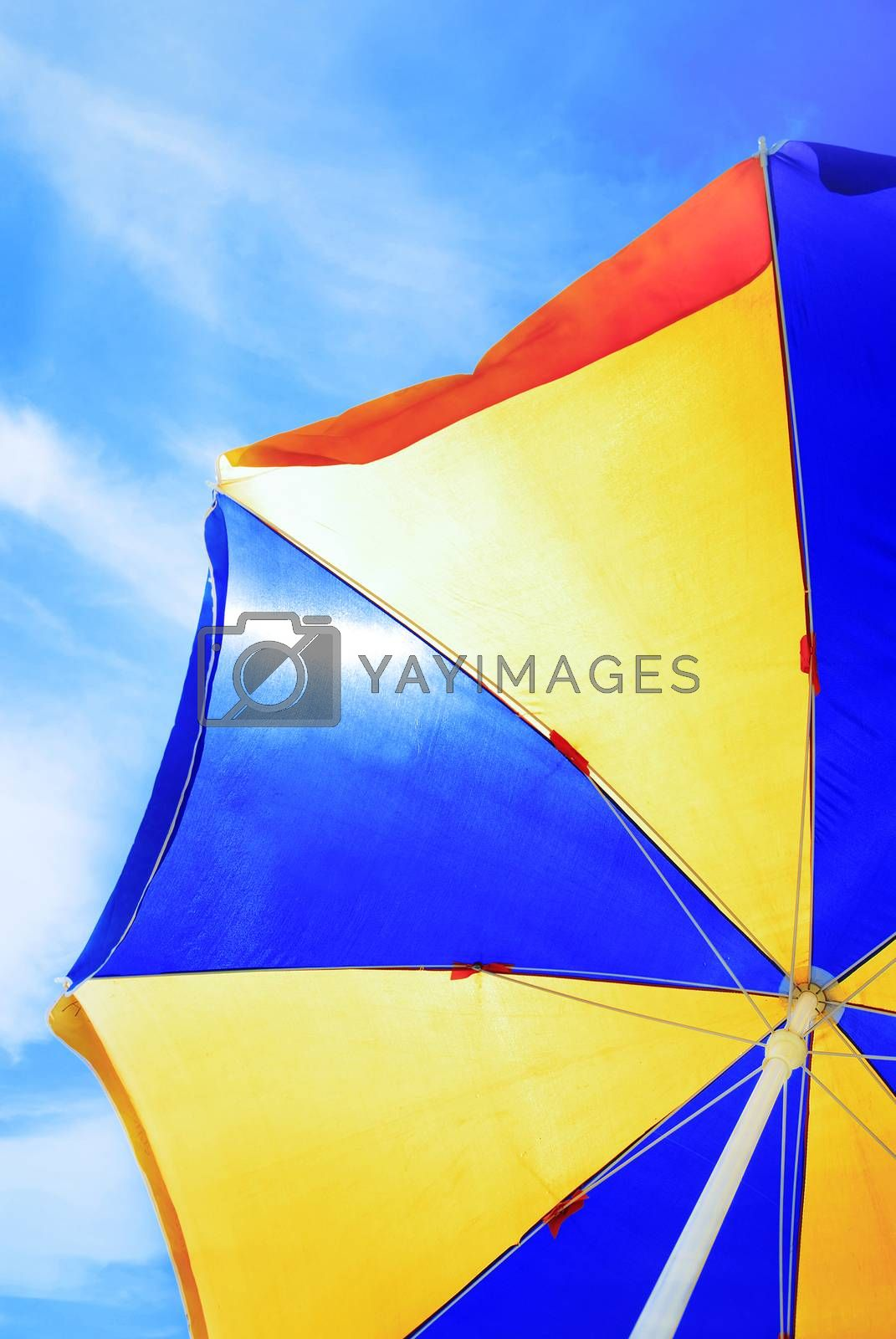 Close-up photo of the beach umbrella on blue sky