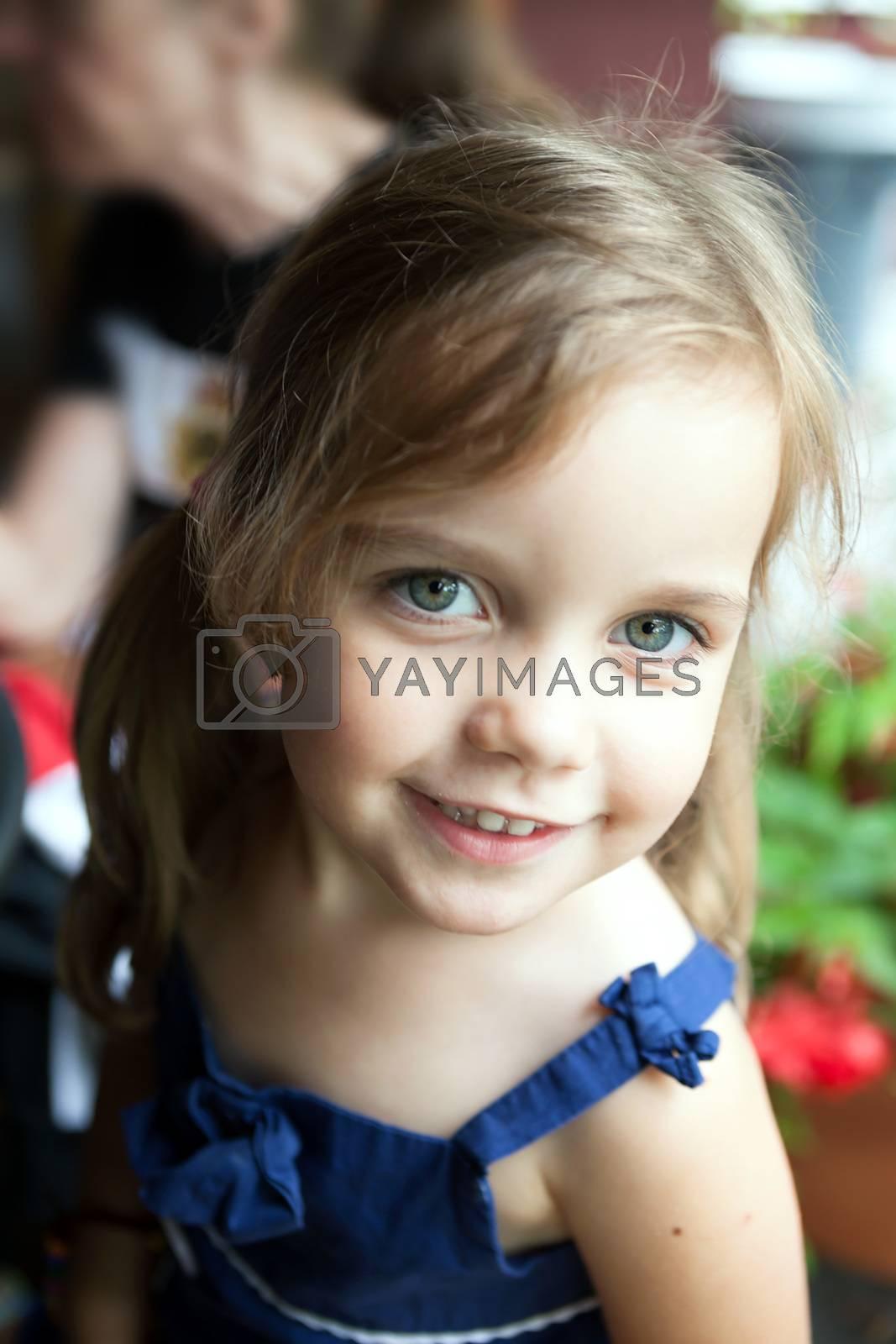 Cute little girl outdoors.  Shallow depth of field.