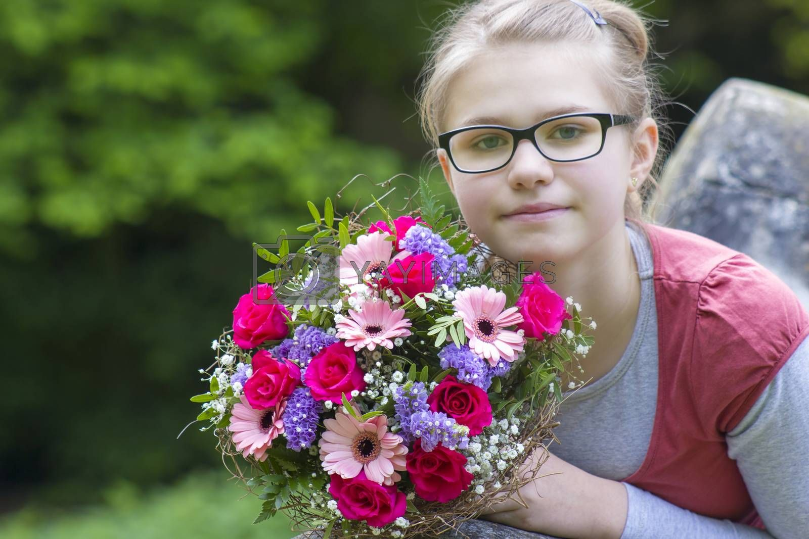 cute young girl with flowers - gift for the mother