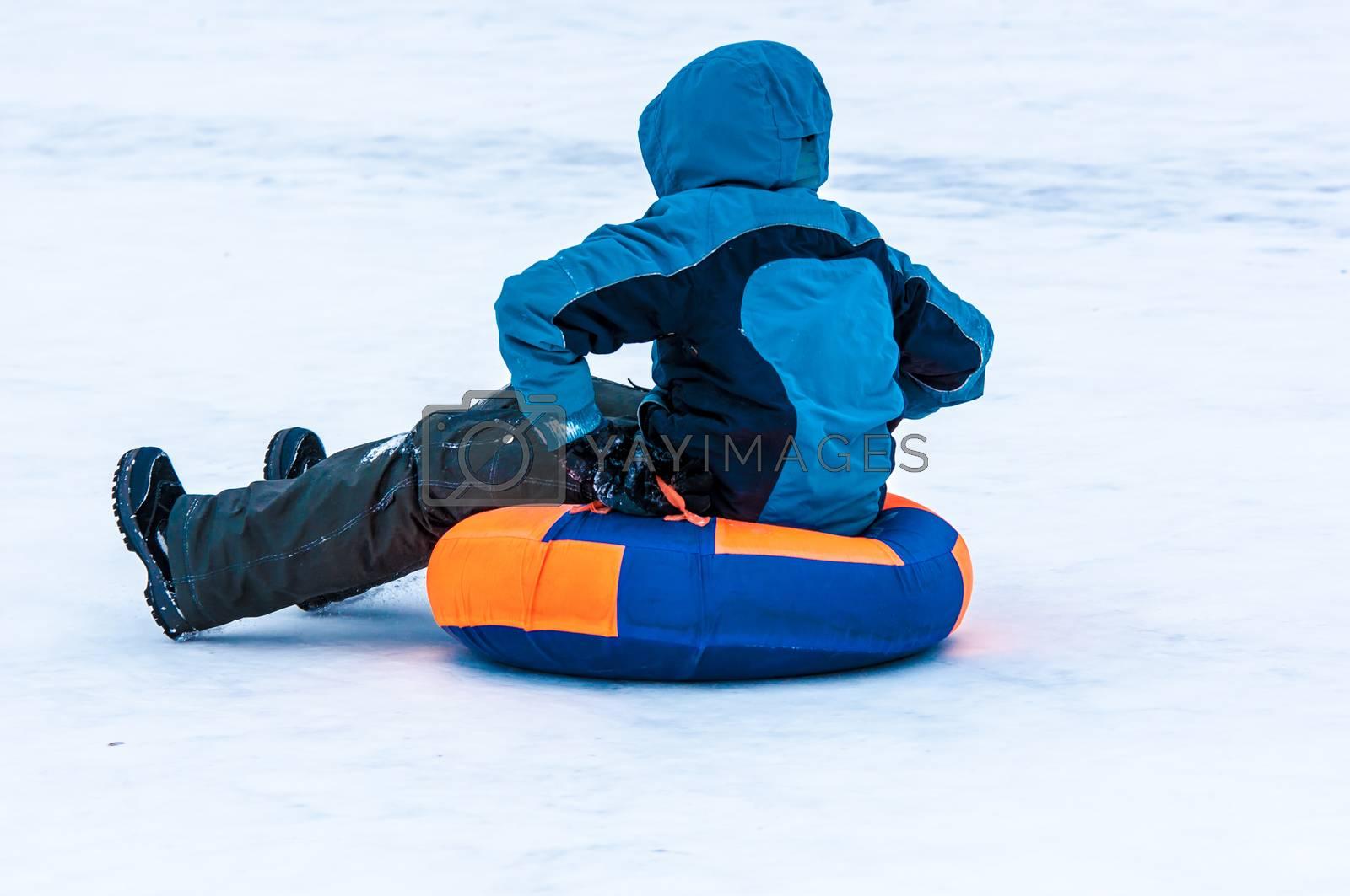 ORENBURG - 18 January: Baby winter sledding on the Ural River  18 January 2015 year in ORENBURG, ORENBURG region, RUSSIA.
