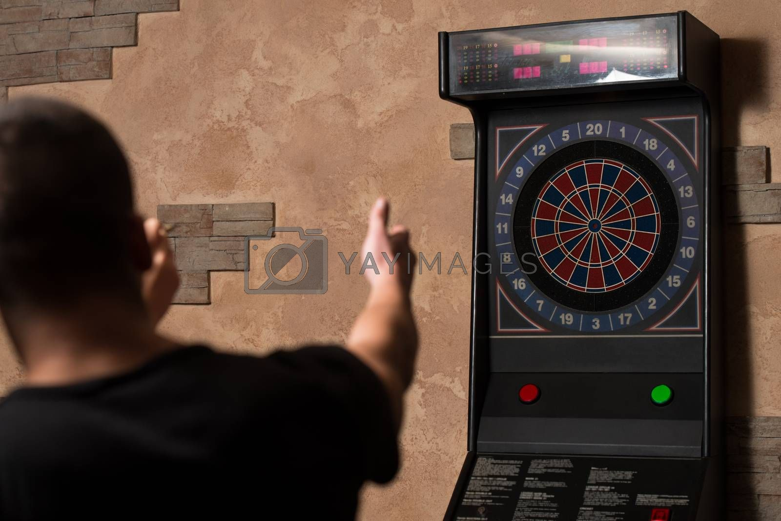 Young Couple Playing A Game Shooting Darts