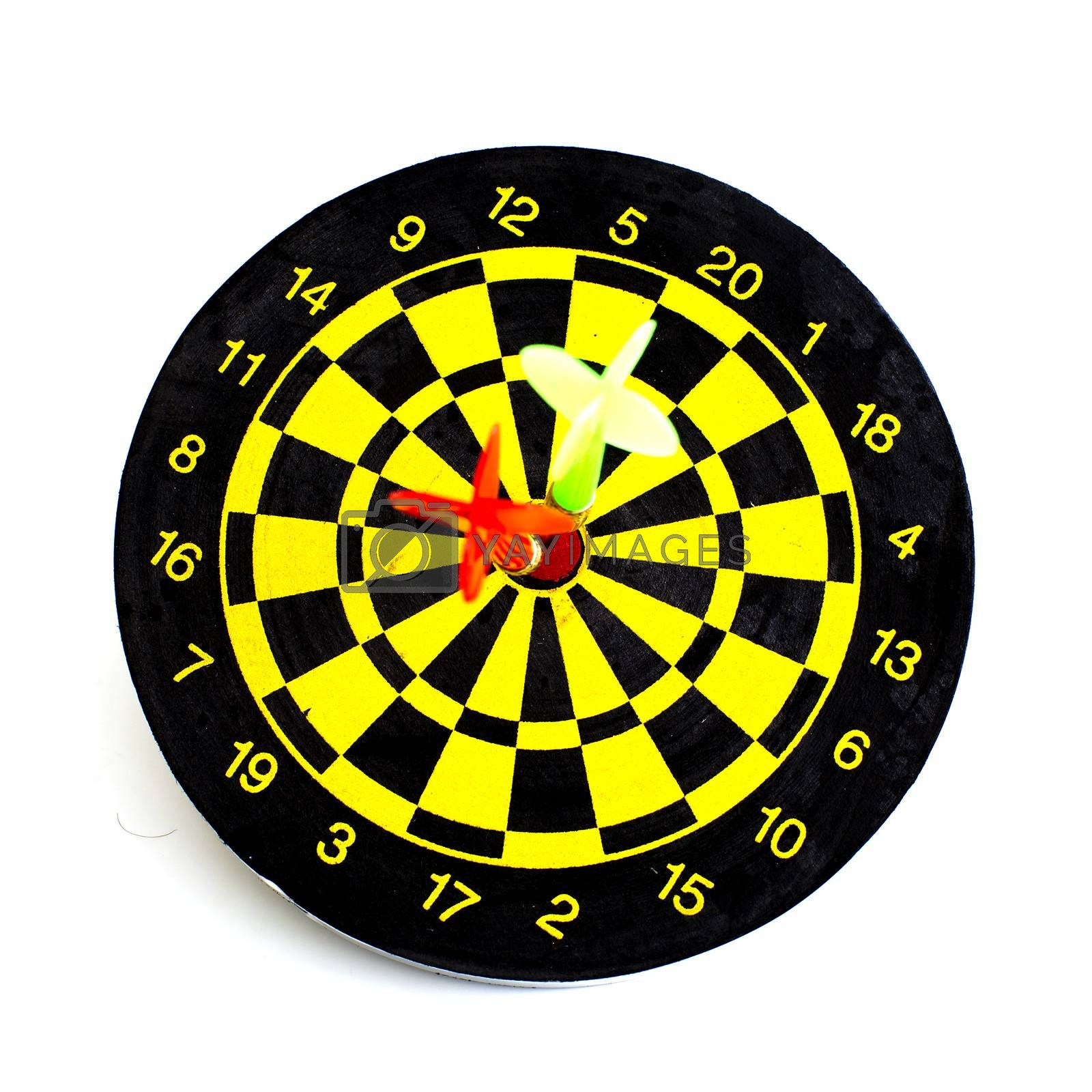 Two darts in center of target isolated on white