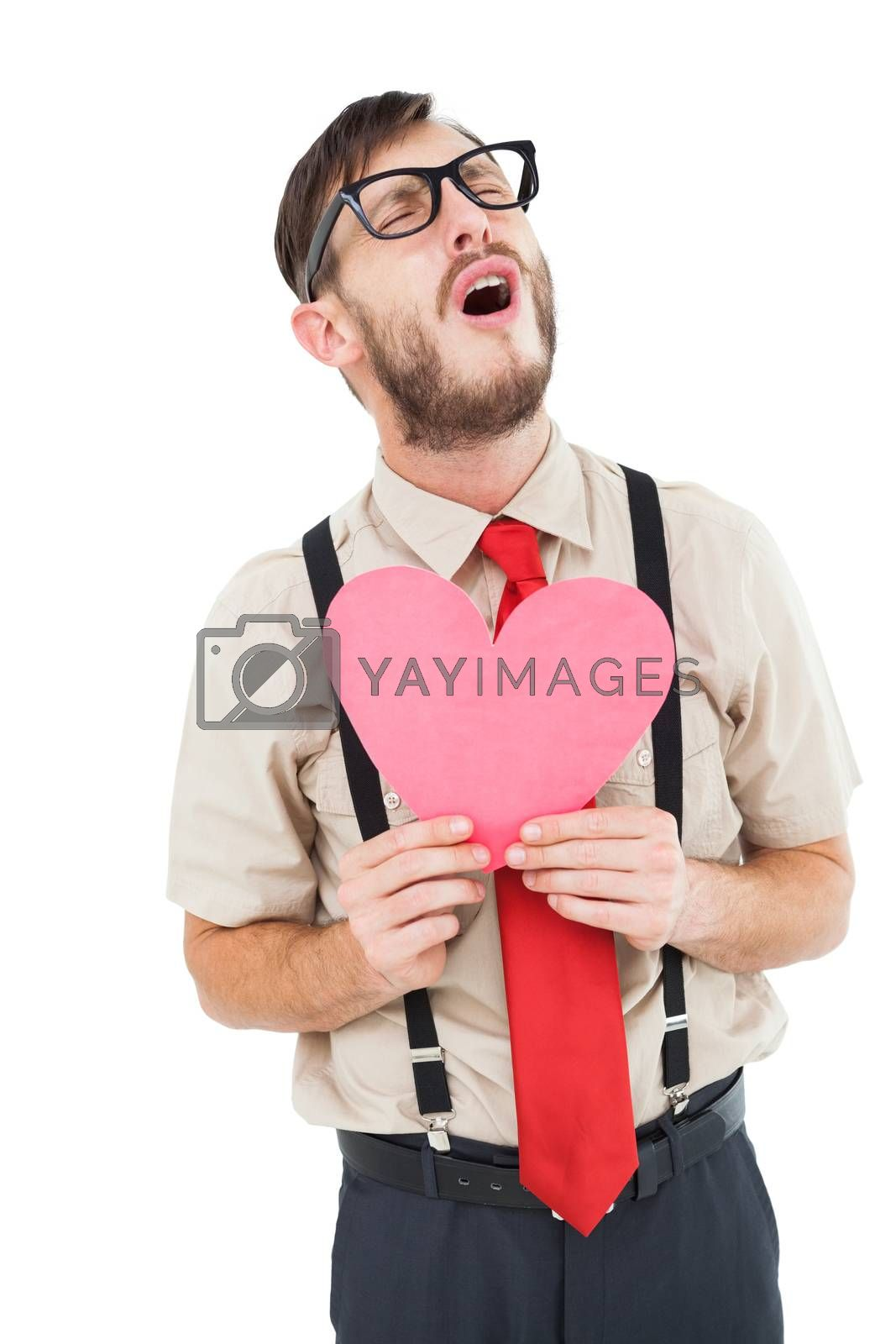 Geeky hipster crying and holding heart card on white background