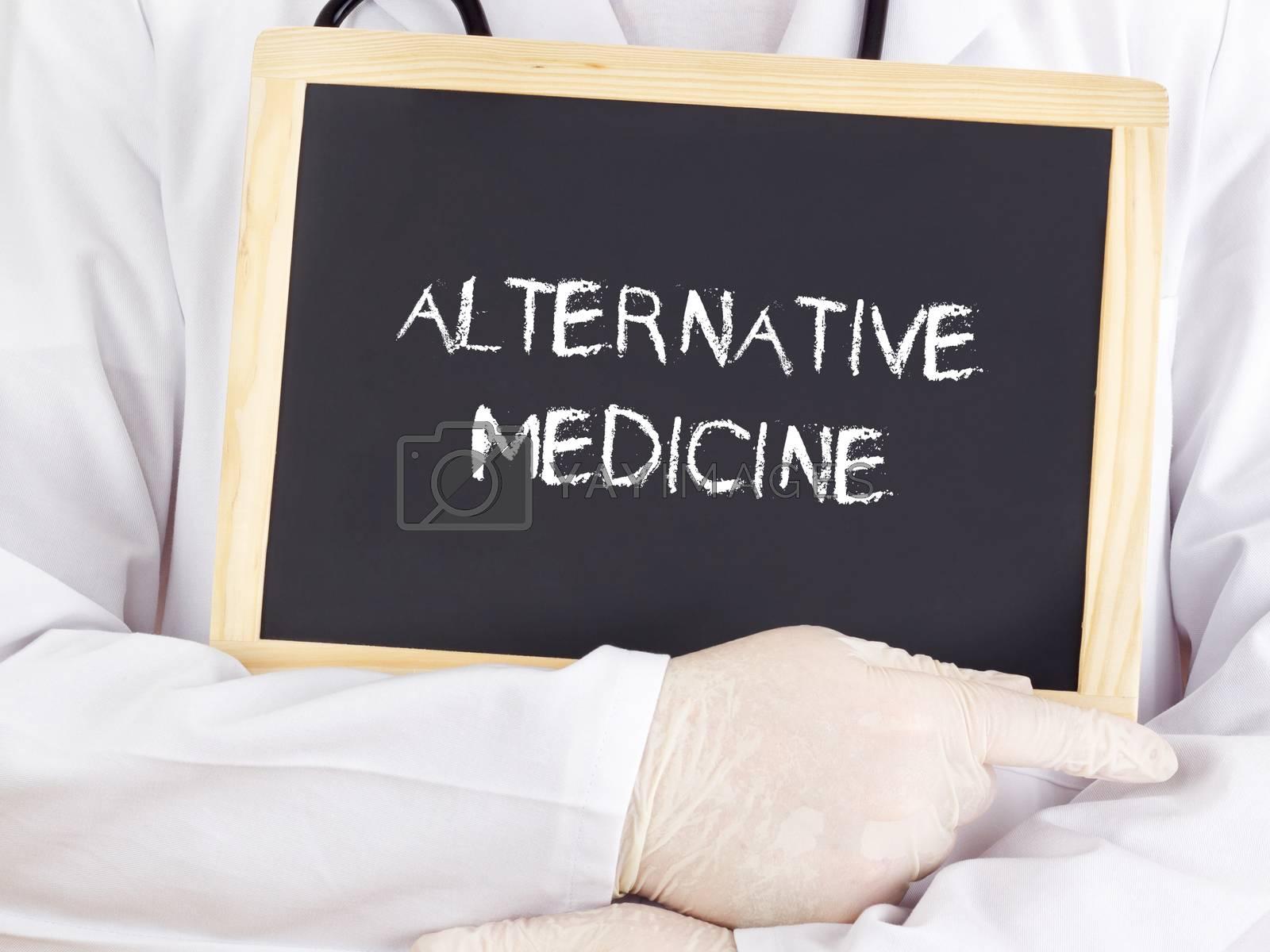 Doctor shows information on blackboard: alternative medicine