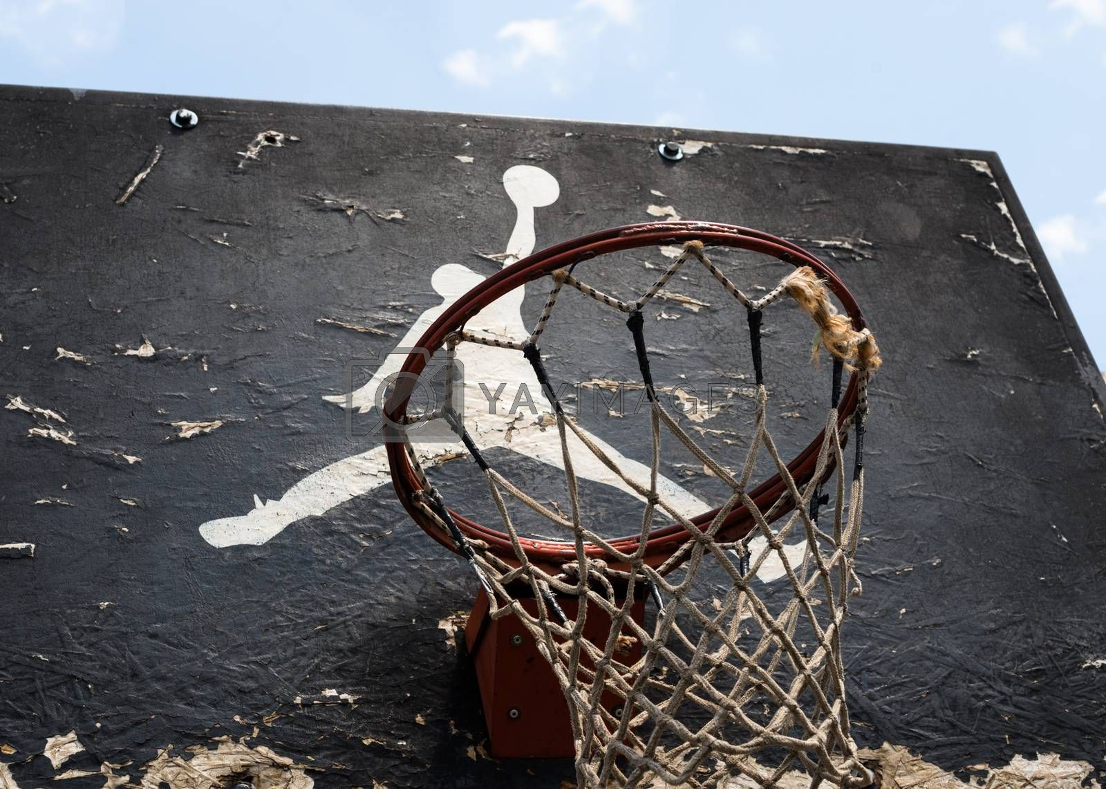 KYIV, UKRAINE -  JUNE 17, 2014: Jumpman logo by Nike painted on the black backboard of the old basketball court in Kyiv.