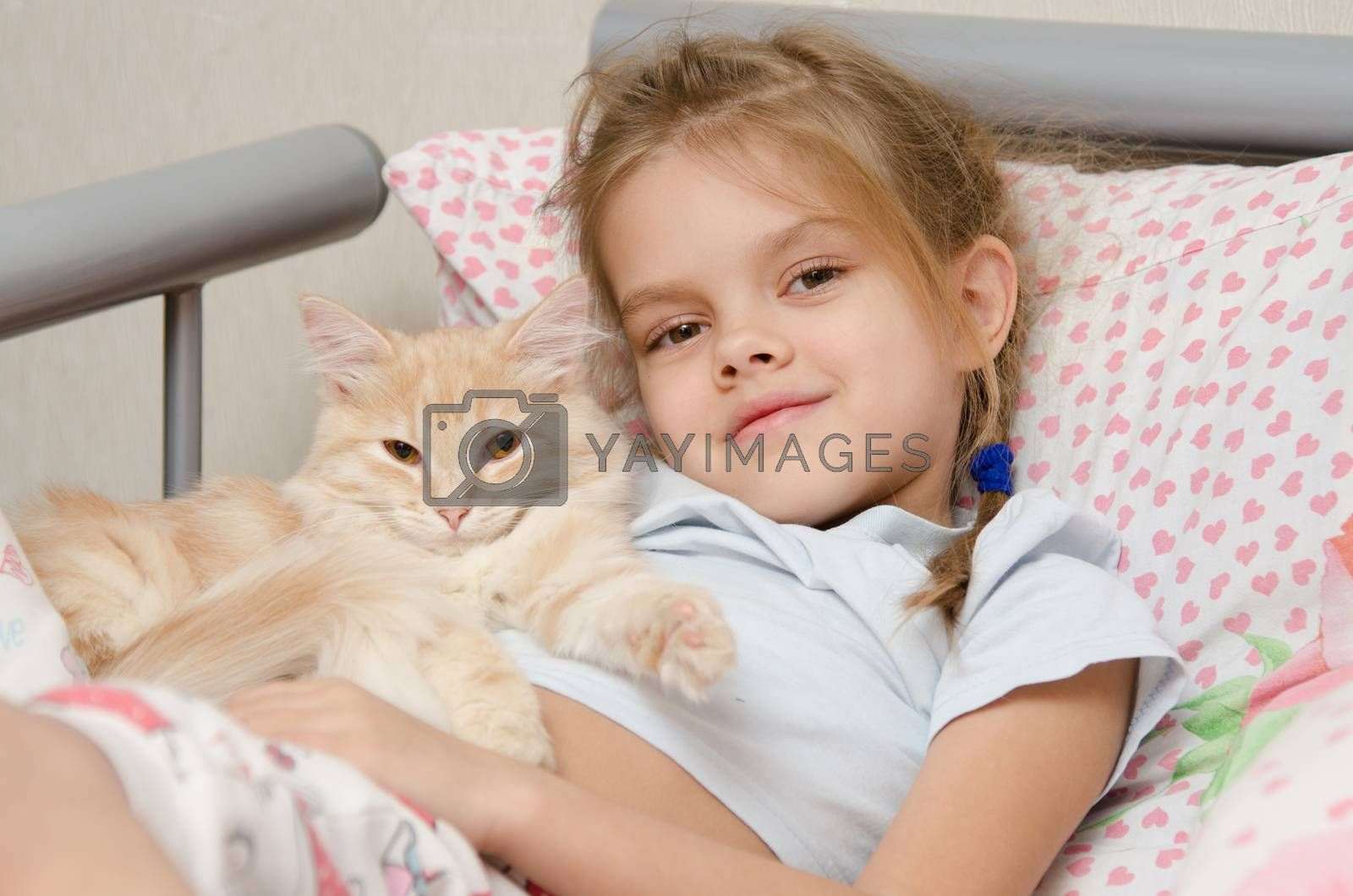 Portrait of the girl with a cat lying in bed by Madhourse