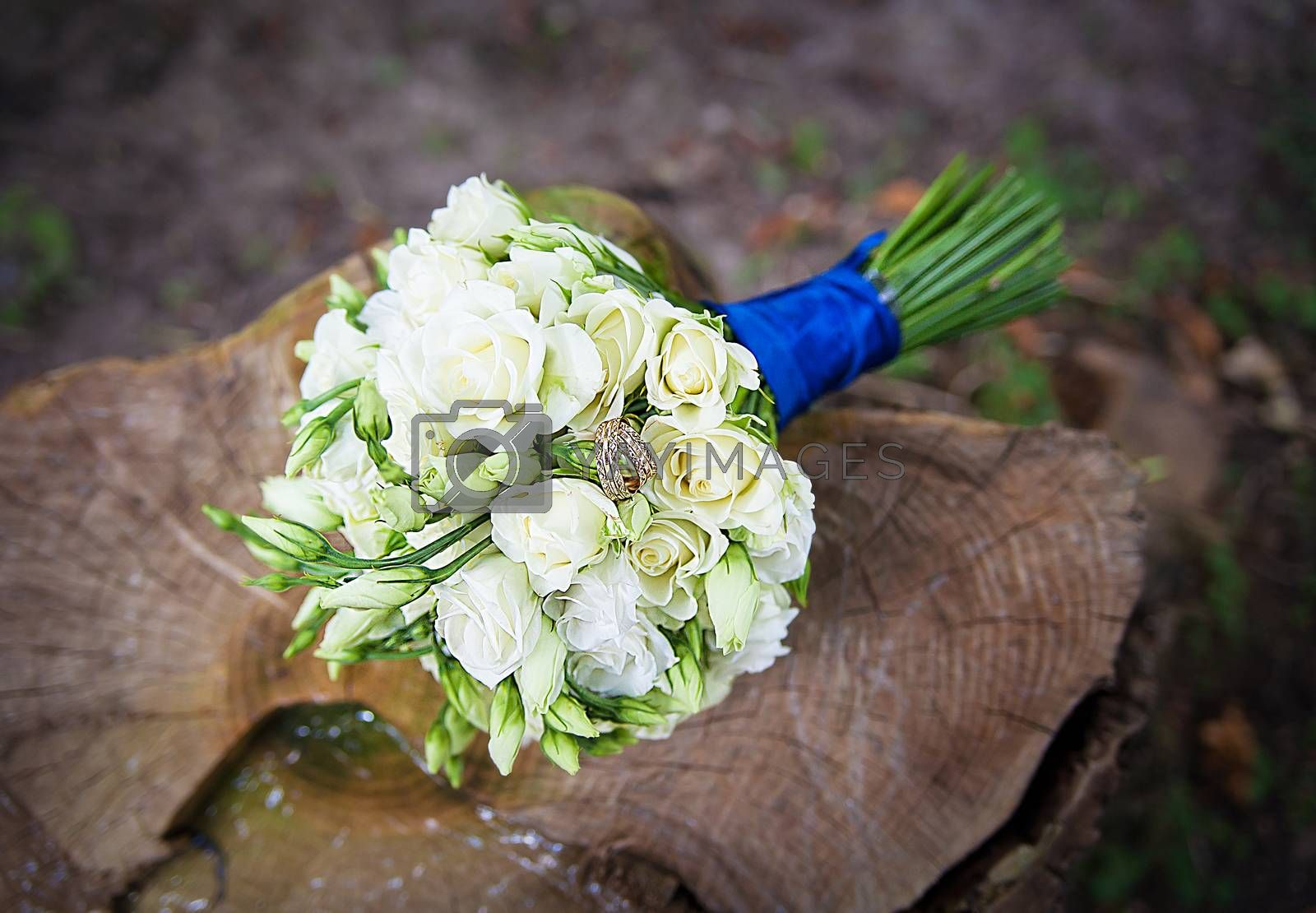 Royalty free image of Wedding golden rings on bridal bouquet by sfinks