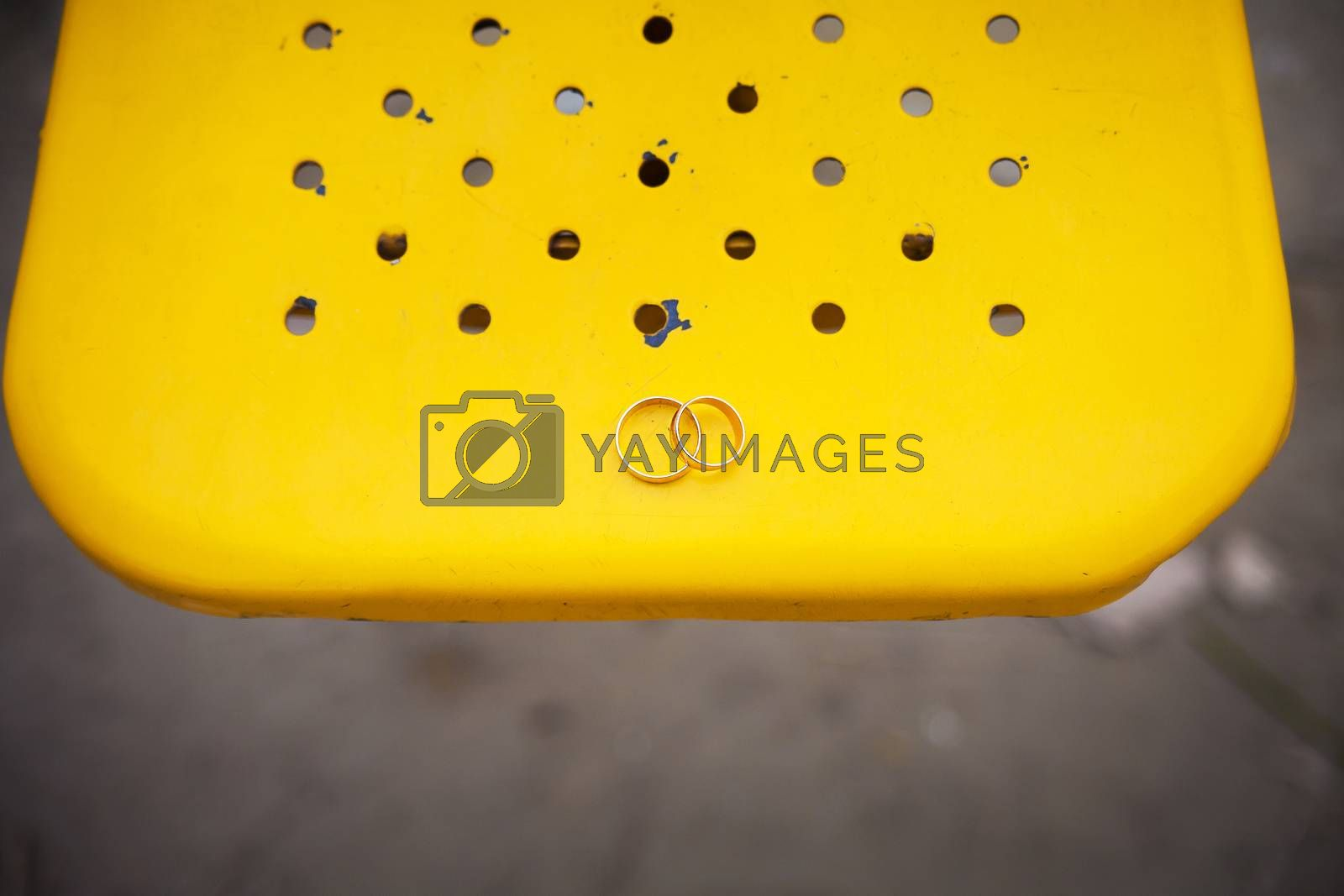 Royalty free image of Two wedding rings on a yellow background. by sfinks