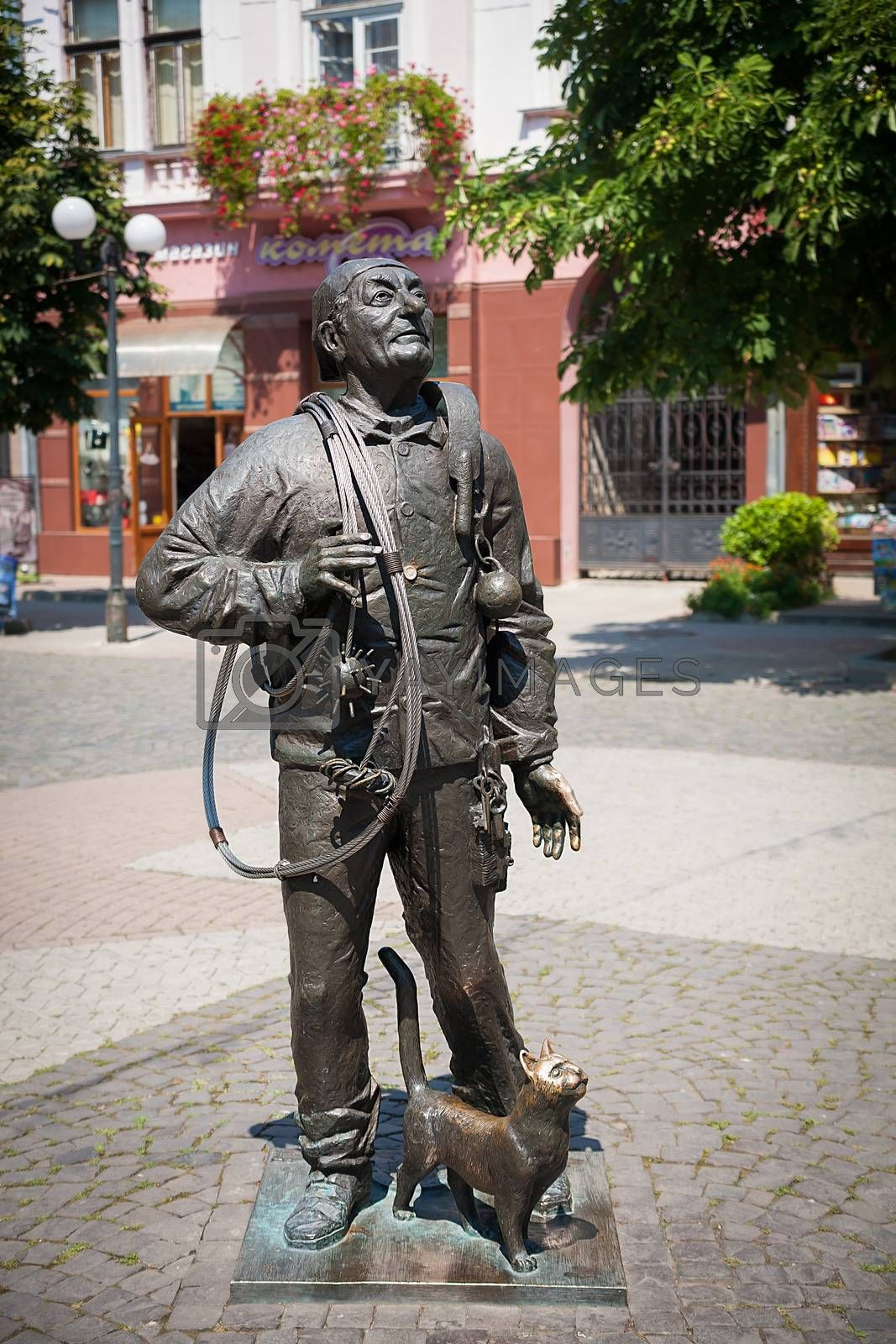 Royalty free image of Monument of Happy Chimney Sweeper with cat by sfinks