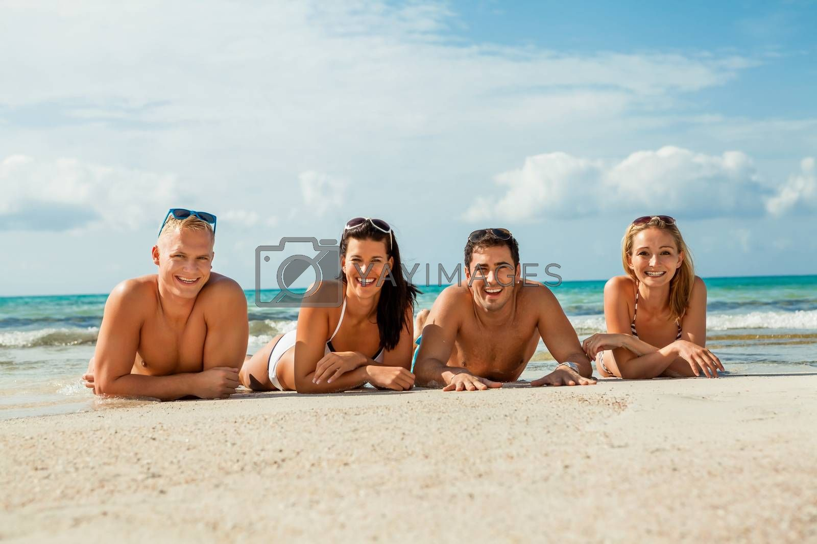 young happy friends havin fun on the beach summer holidays lifestyle