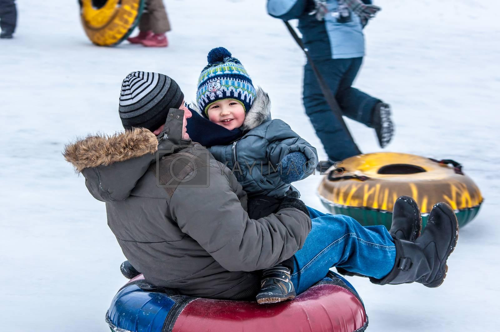 Orenburg, Orenburg region, Russia - 18 January 2015: Baby winter sledding on the Ural River