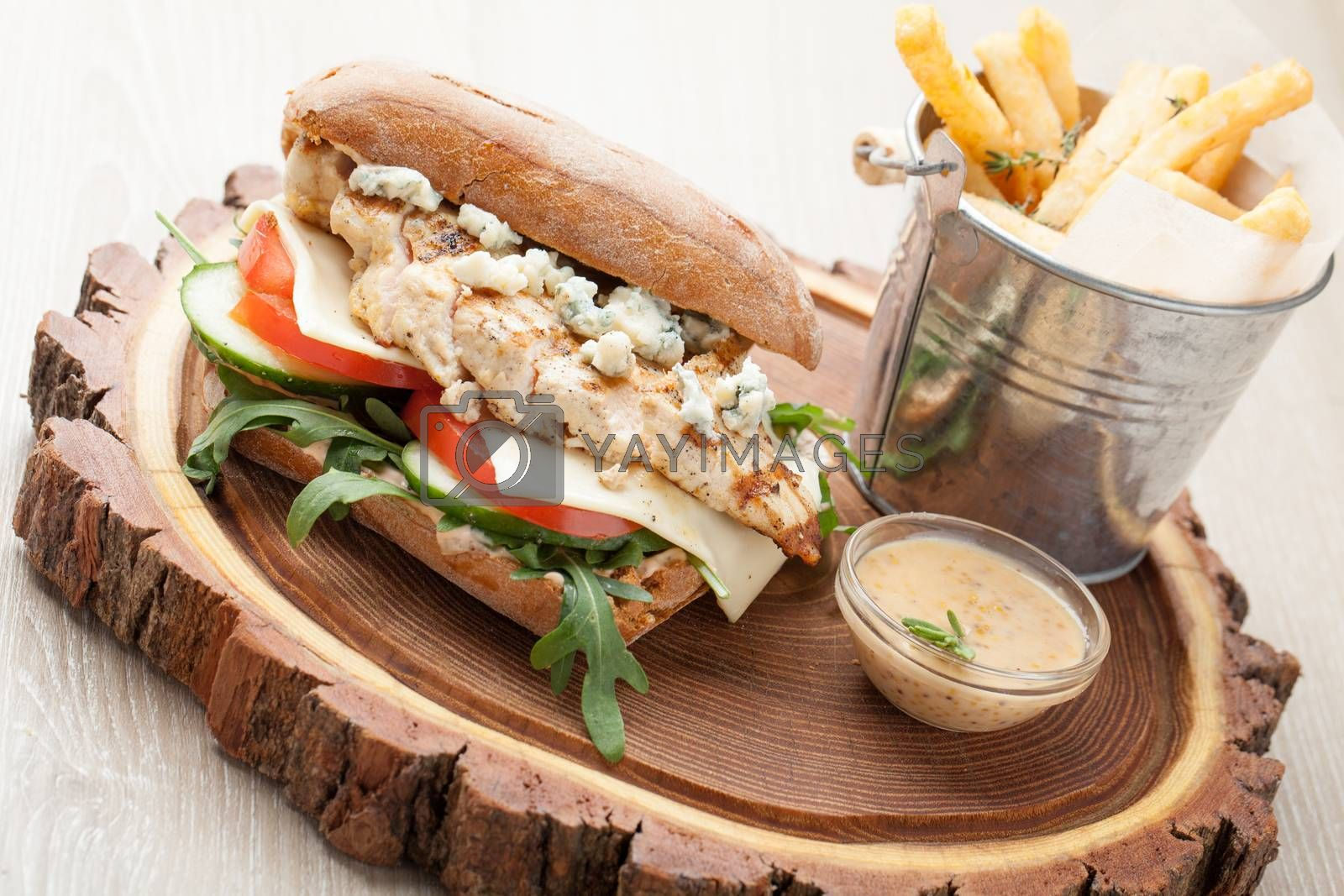 Royalty free image of Wheat chicken sandwich burger, fried potatoes, mustard sauce. Se by SergeyAK