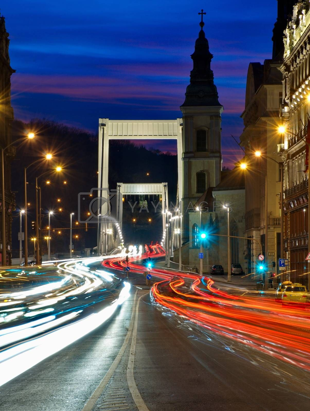 Traffic on the bridge at night in Budapest, Hungary