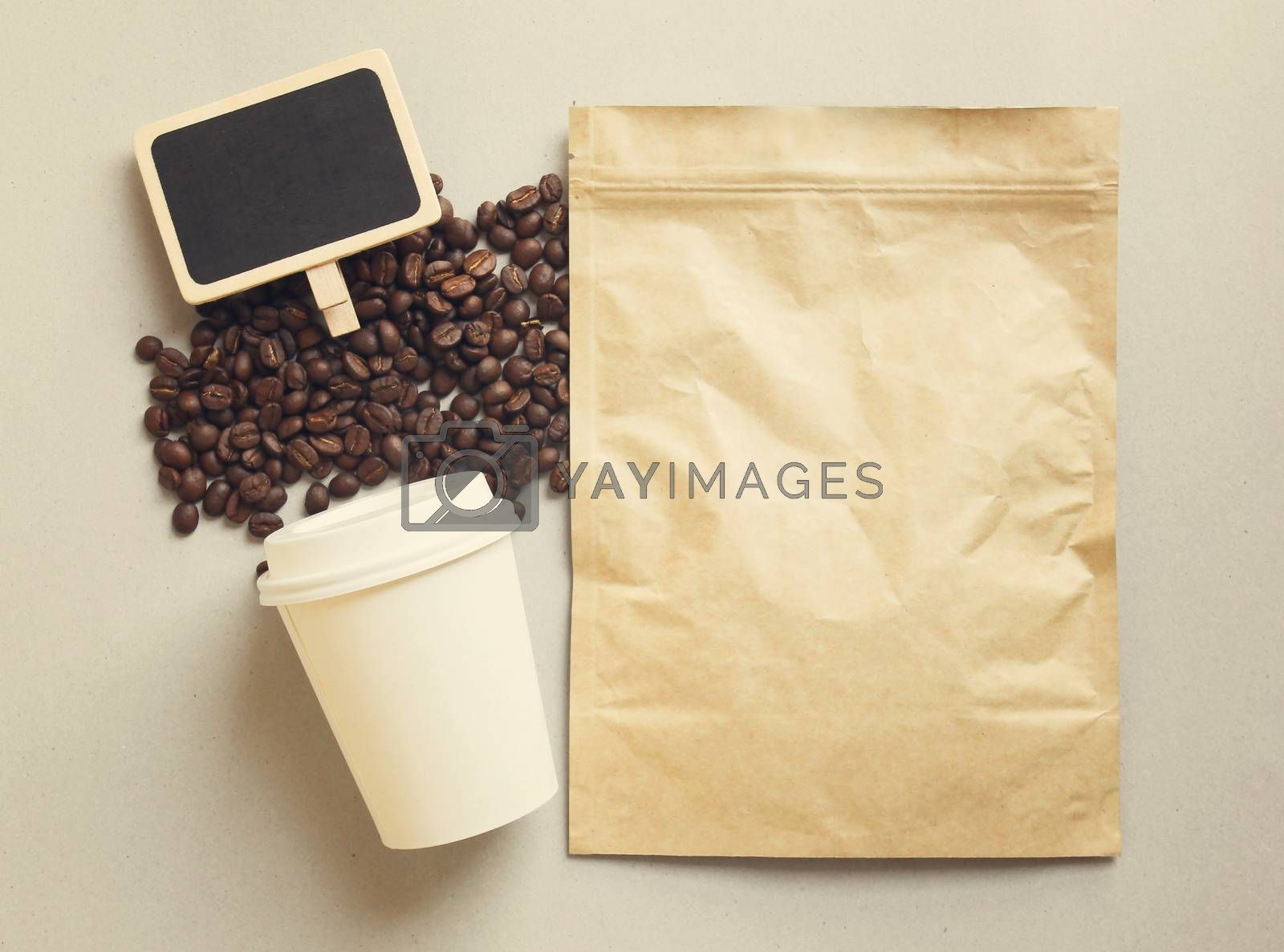Bag of coffee and blank blackboard with paper cup, retro filter effect