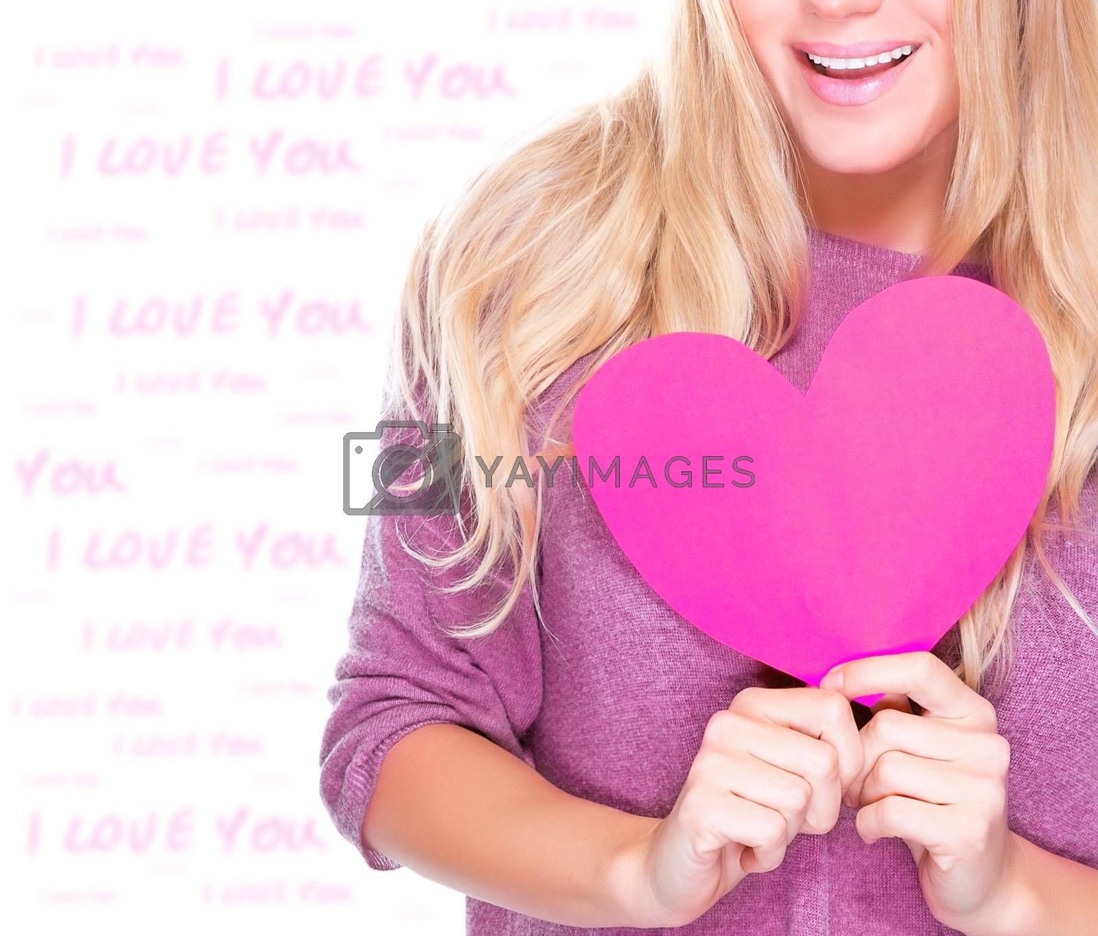 Closeup photo of body part of cute blond woman holding in hands pink paper heart, romantic feelings, happy Valentine day concept
