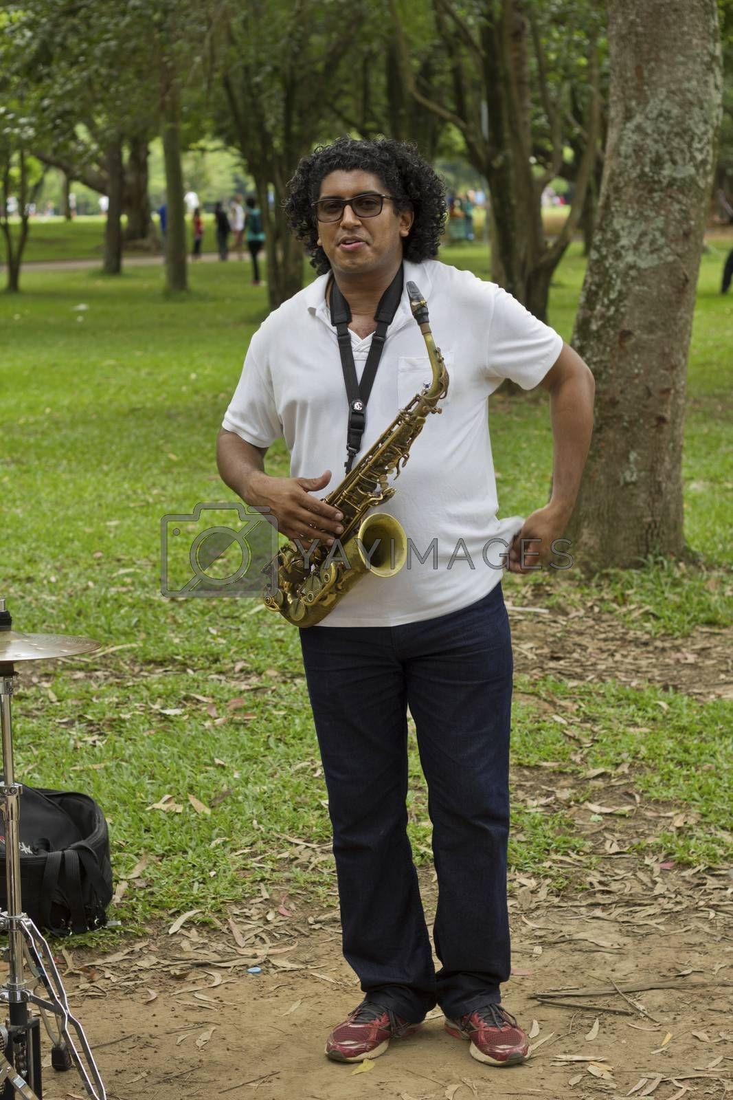 SAO PAULO, BRAZIL - FEBRUARY 01, 2015: An unidentified street musician playing saxophone in the Ibirapuera Park at Sao Paulo Brazil.