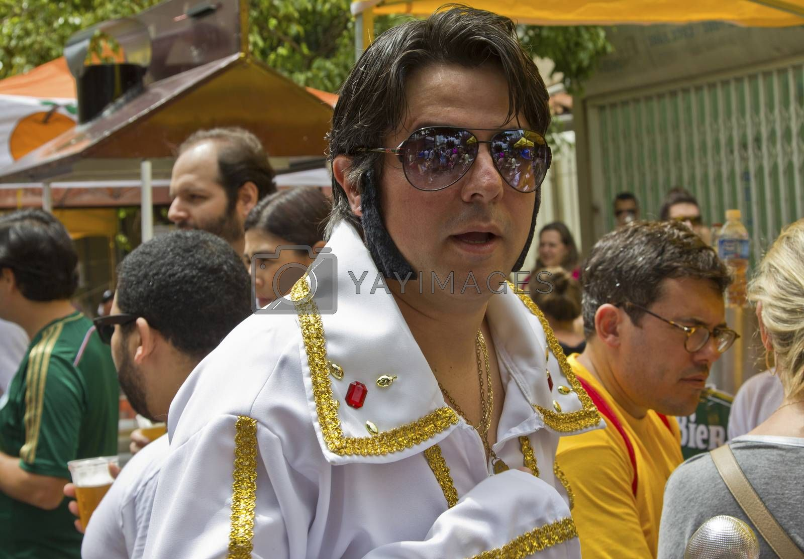 SAO PAULO, BRAZIL - JANUARY 31, 2015: An unidentified man dressed like Elvis Presley participate in the annual Brazilian street carnival dancing and singing samba.