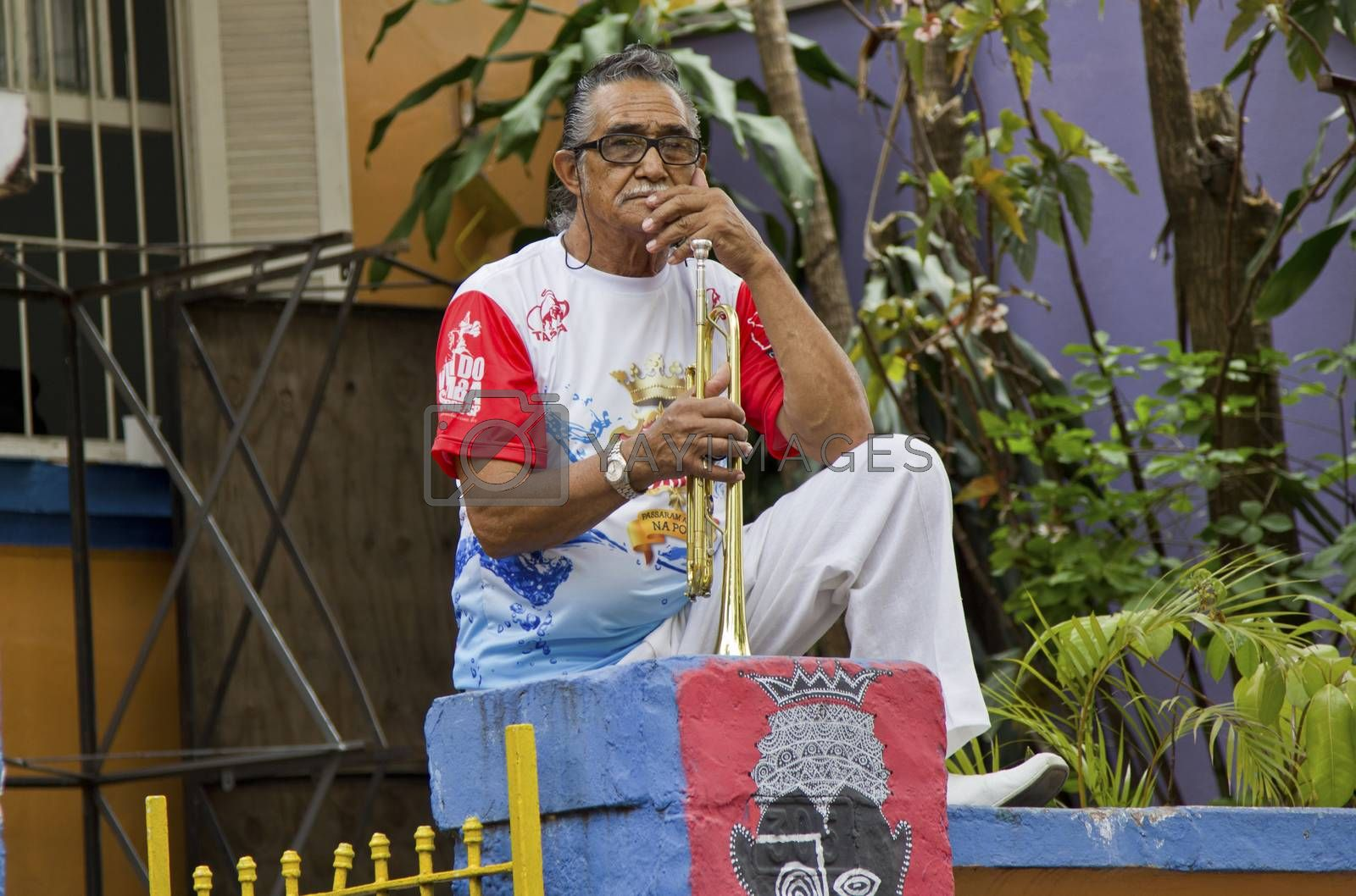 SAO PAULO, BRAZIL - JANUARY 31, 2015: An unidentified man with a trumpet of a traditional samba band participate in the annual Brazilian street carnival.