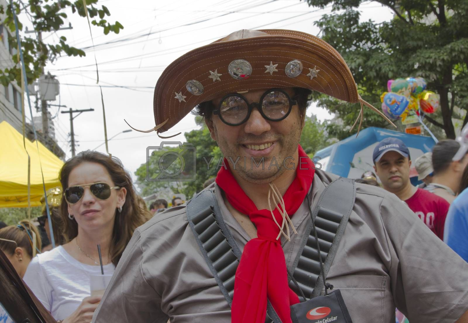 SAO PAULO, BRAZIL - JANUARY 31, 2015: An unidentified man dressed like a old outlaw participate in the annual Brazilian street carnival dancing and singing samba.