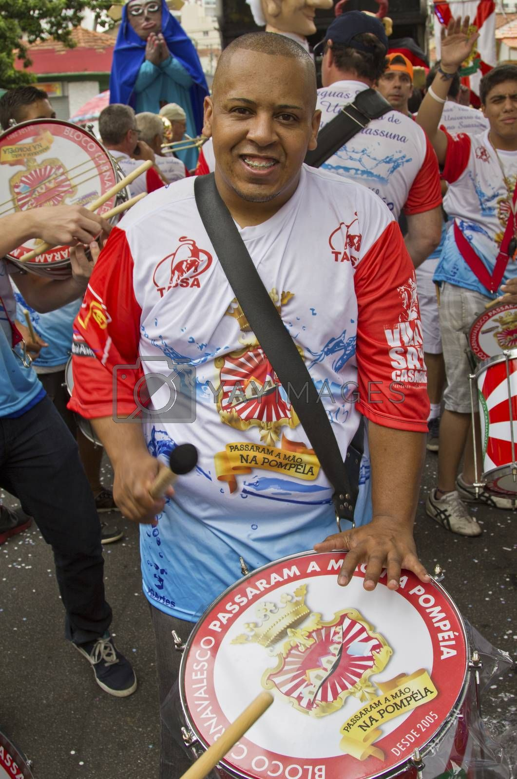 SAO PAULO, BRAZIL - JANUARY 31, 2015: An unidentified man playing drum in a traditional samba band participate at the annual Brazilian street carnival.