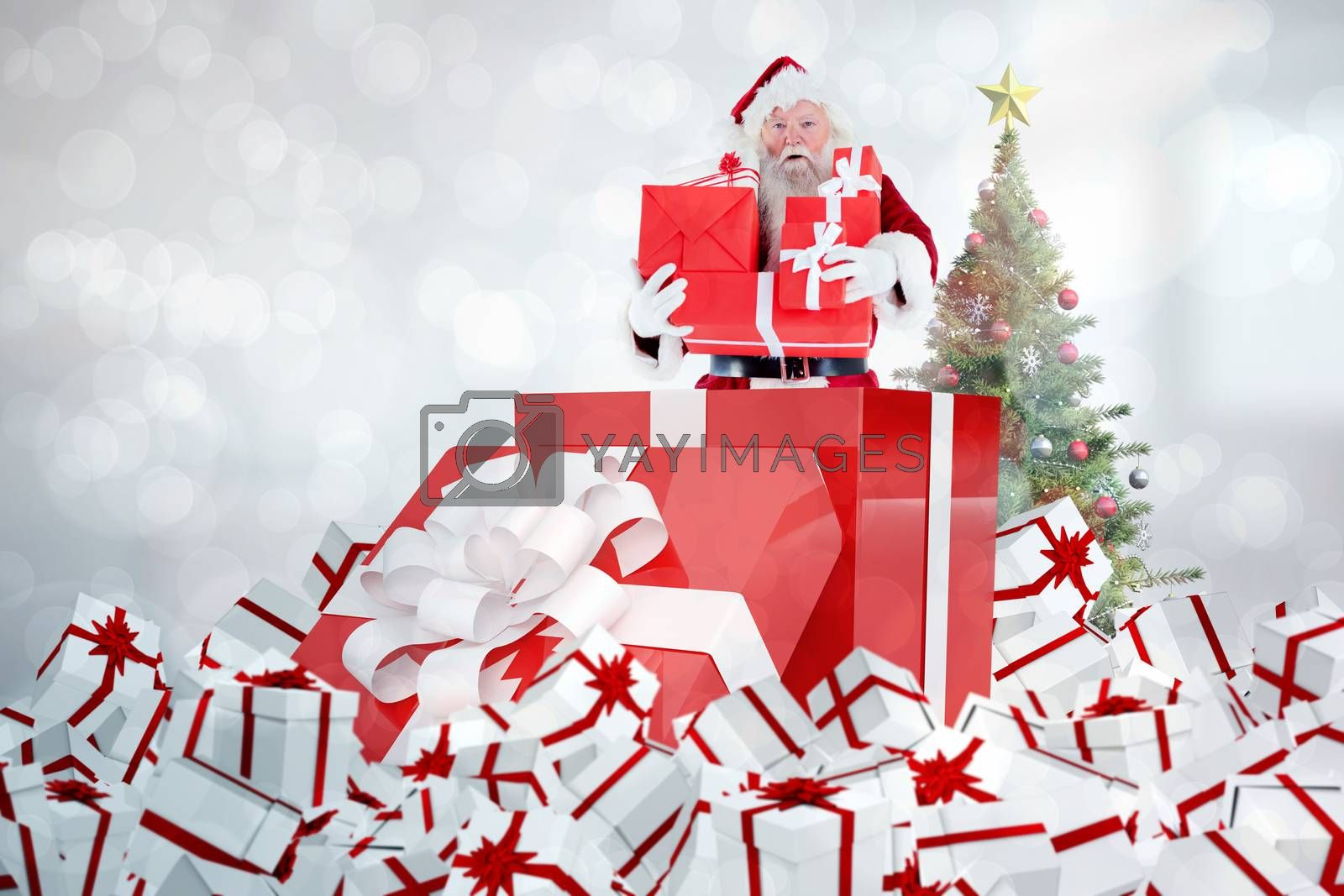 Composite image of santa standing in large gift by Wavebreakmedia