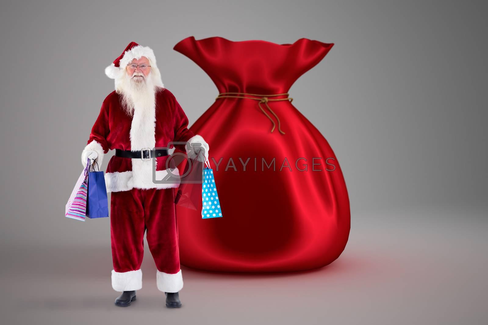 Santa carries some Christmas bags against santa sack full of gifts