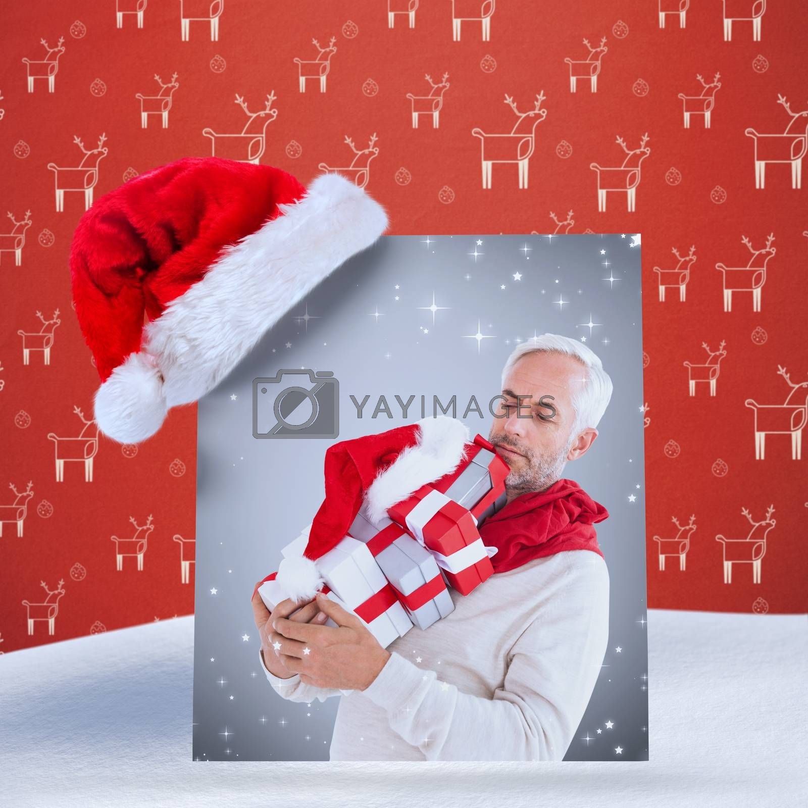 happy festive man with gifts against red reindeer pattern