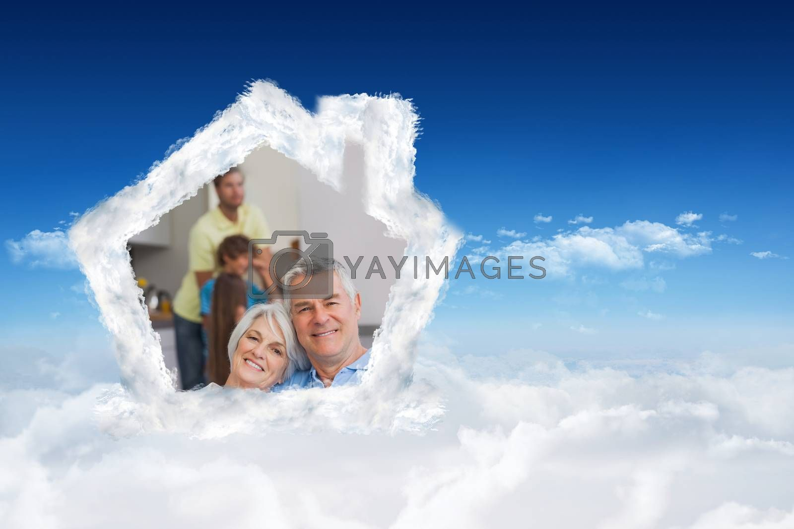 Elderly couple sitting on the couch and smiling at camera  against bright blue sky over clouds