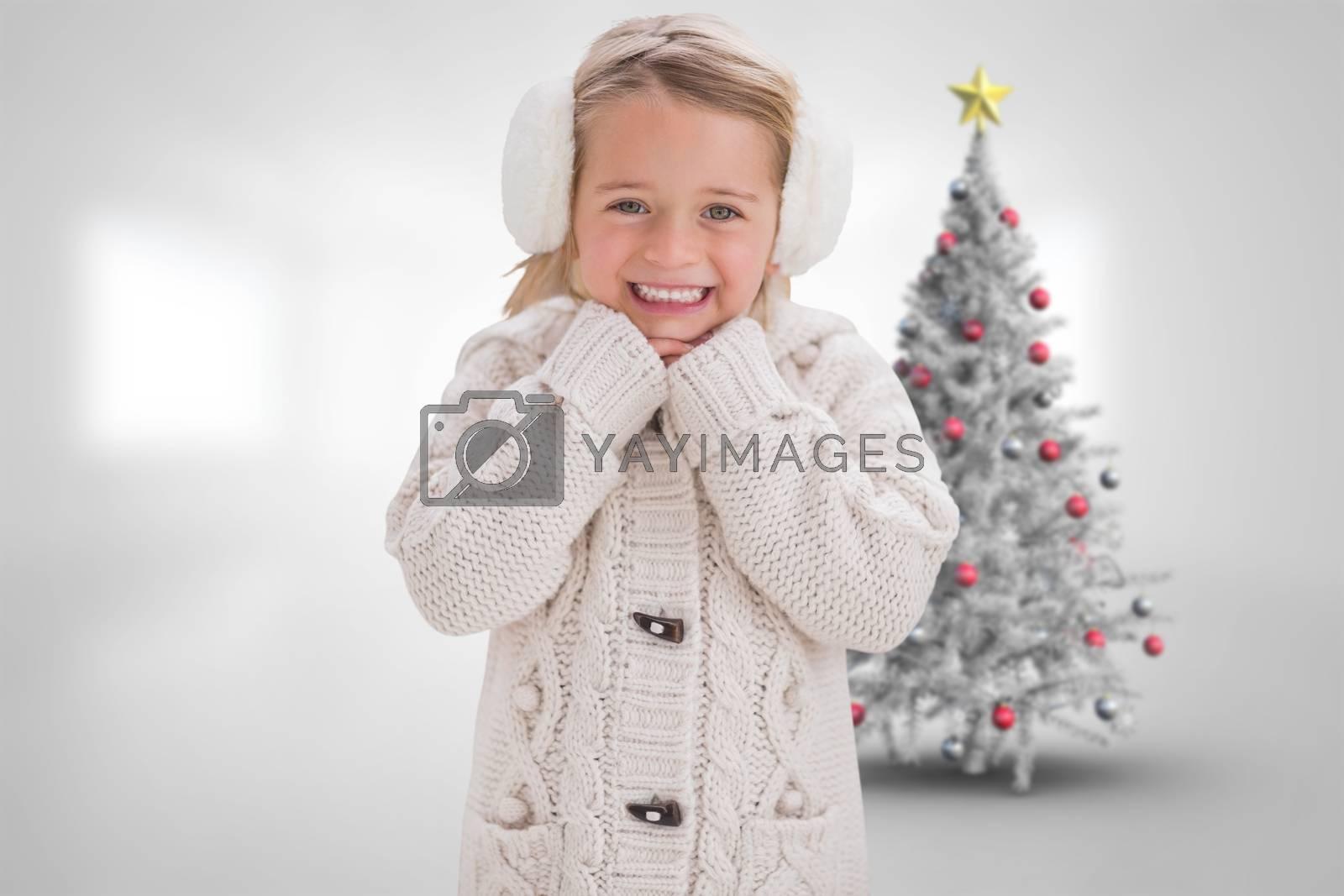 Composite image of cute girl in ear muffs by Wavebreakmedia