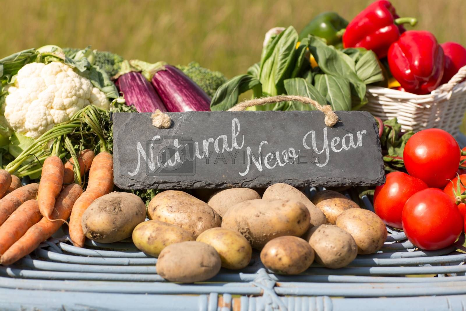 Natural New Year against vegetables at farmers market