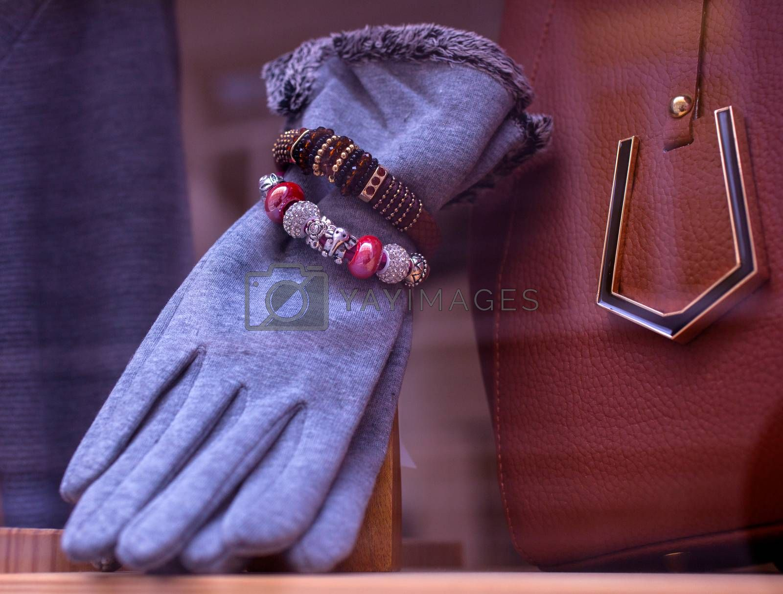 Close up of female gloves and bracelets exposed in the clothes shop