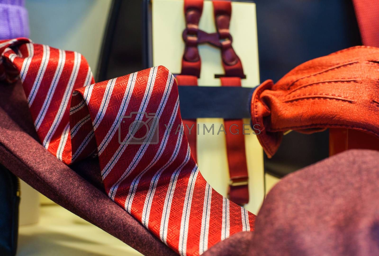 View of striped necktie and red gloves in the clothes shop