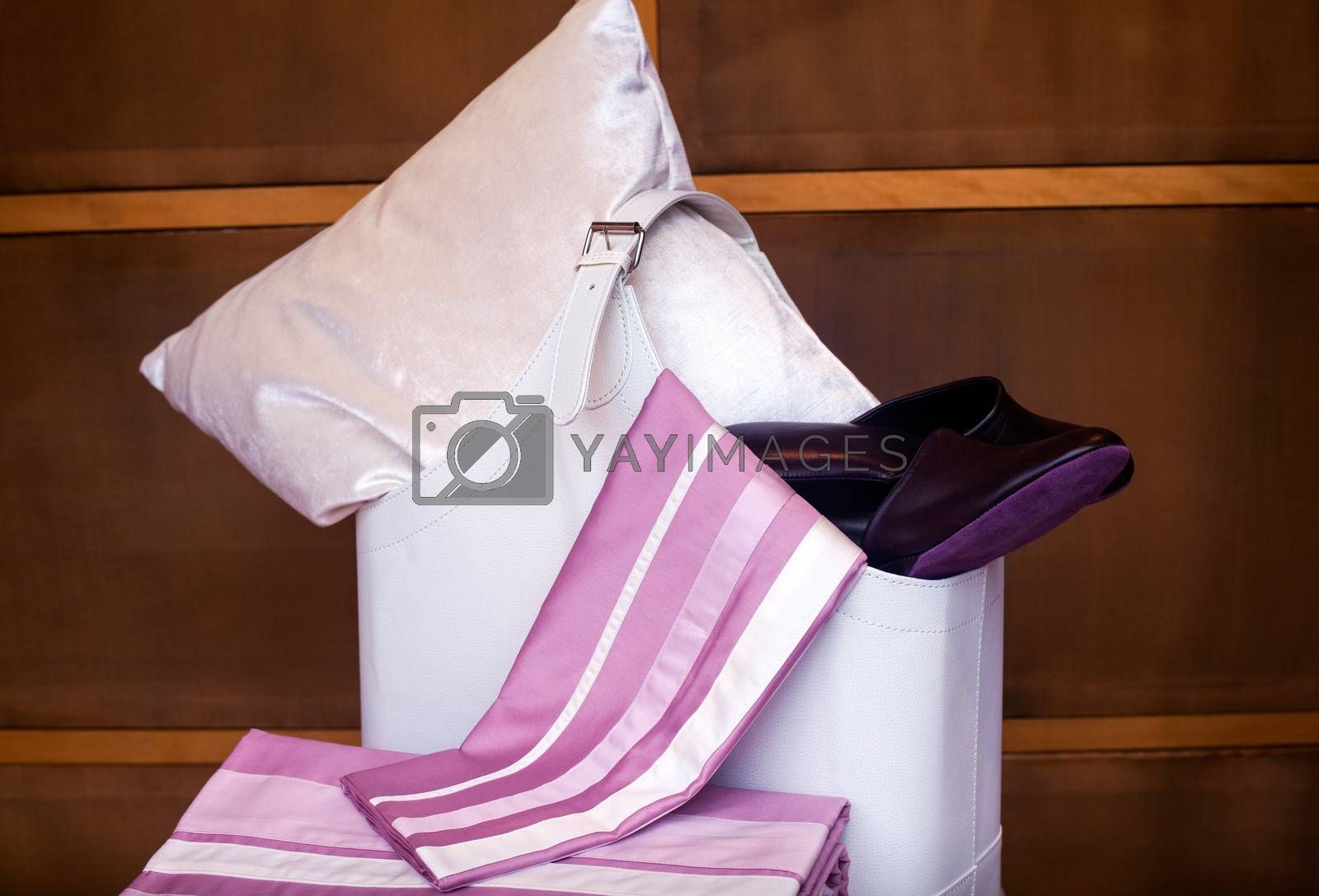 View of female slippers and bedroom accessories