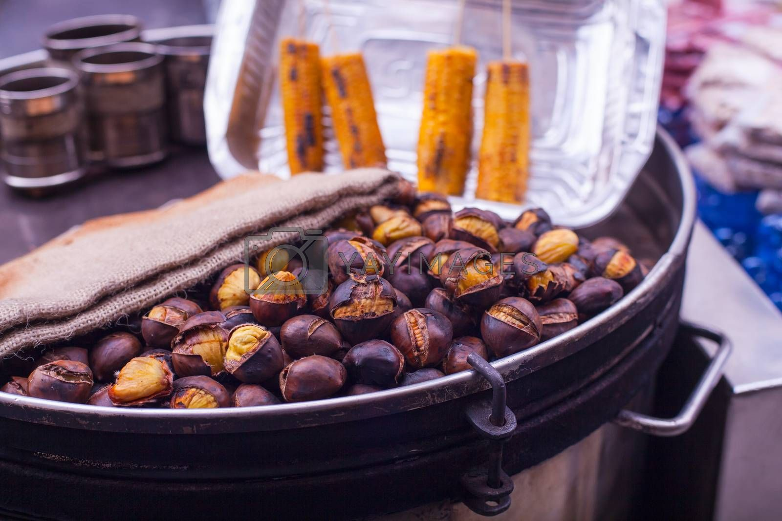 Freshly roasted chestnuts inside a iron plate