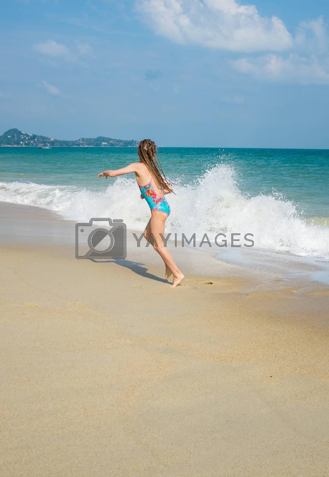 little girl on the sunny sea beach