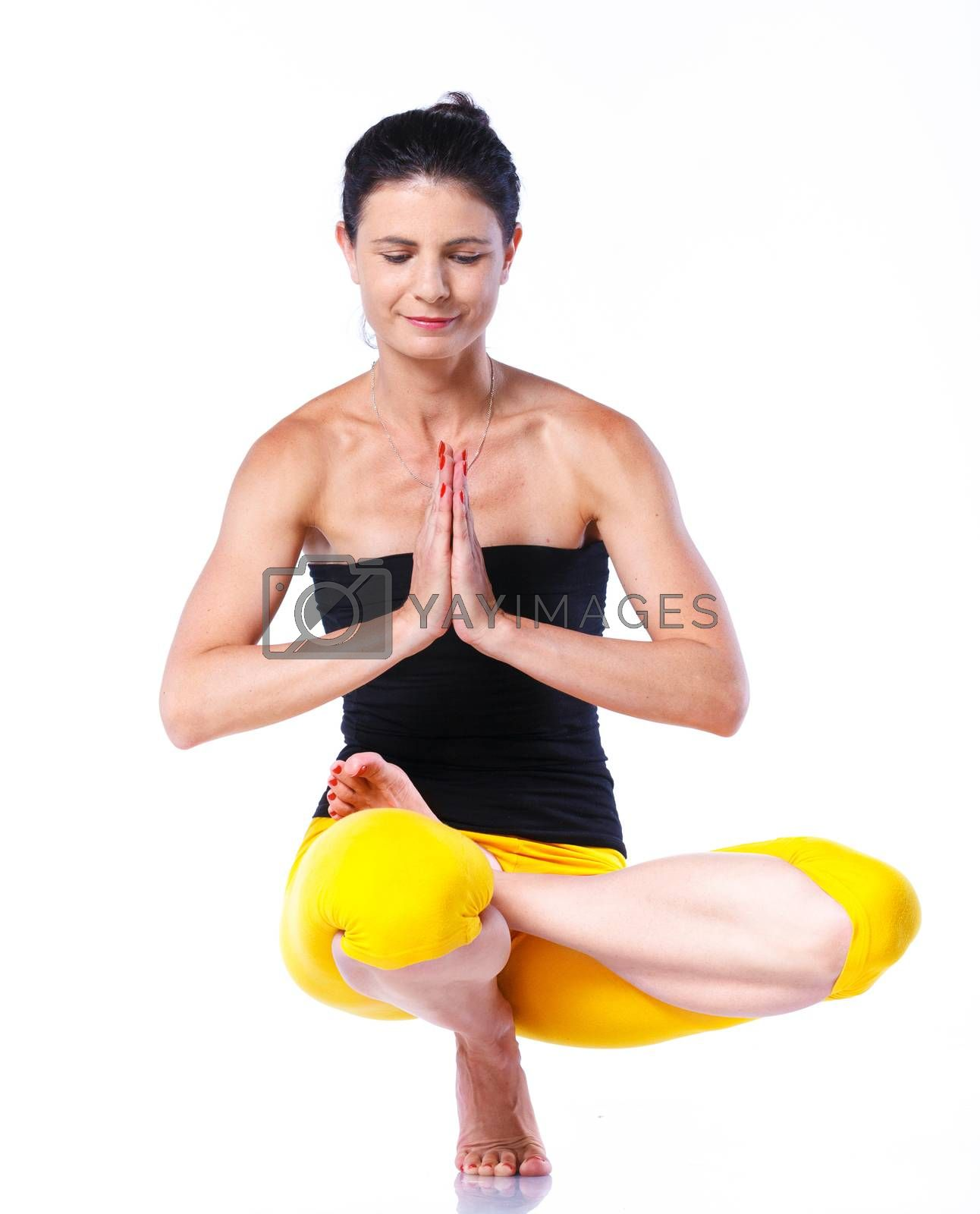 Yoga woman - pretty brunette in active wear doing yoga on white background