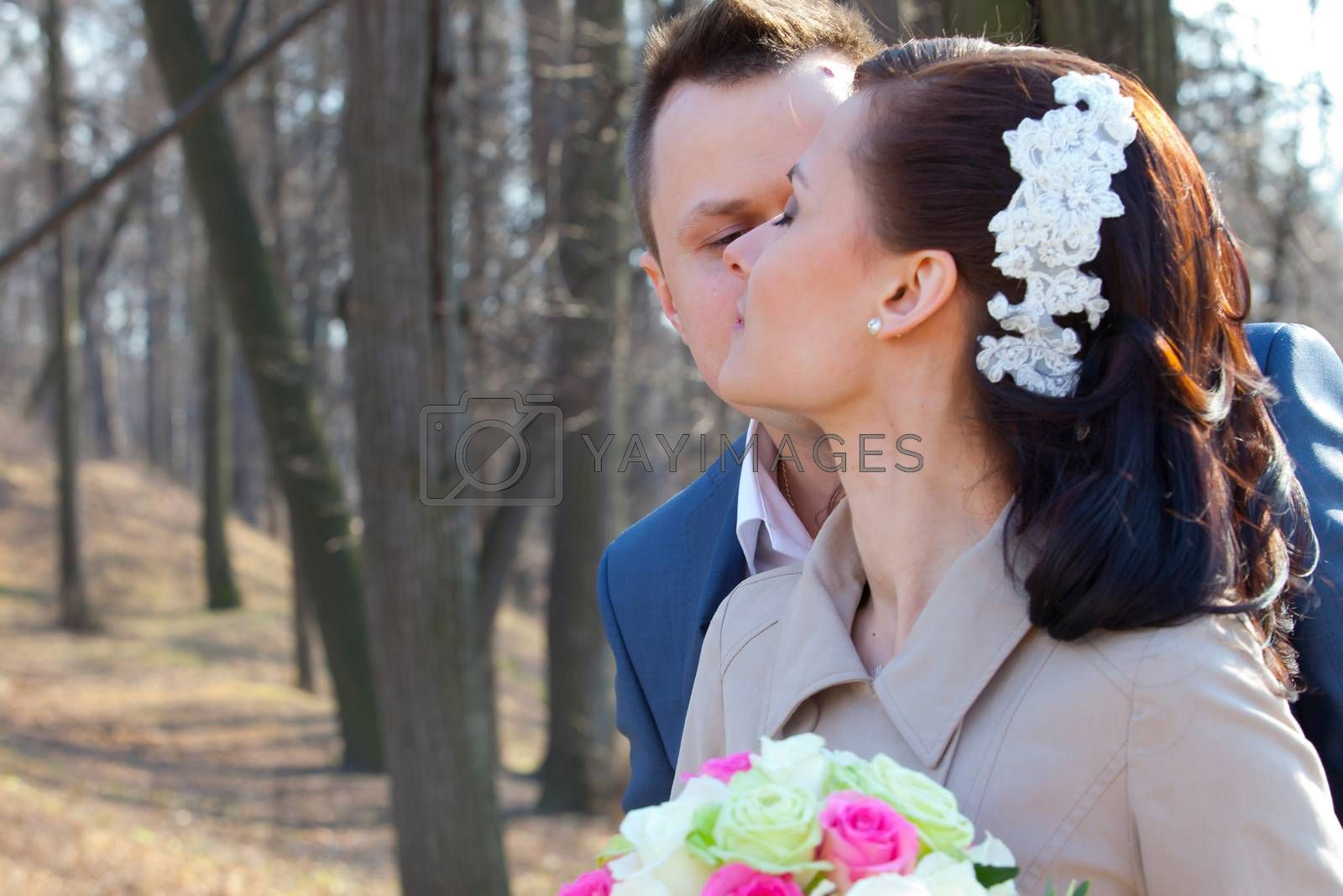 bride and groom on a park background