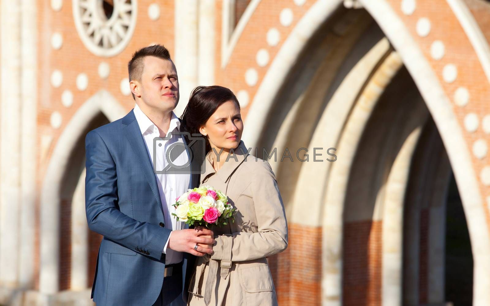 bride and groom on a architectura vintage background