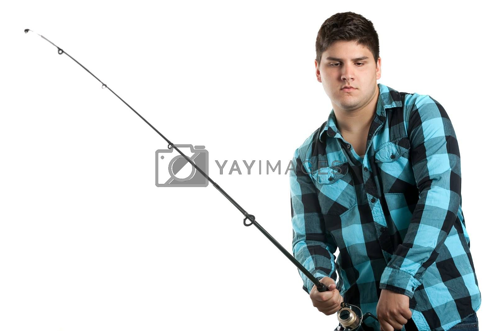 Teenager fishing.  Isolated over white in studio with plenty of copy space.