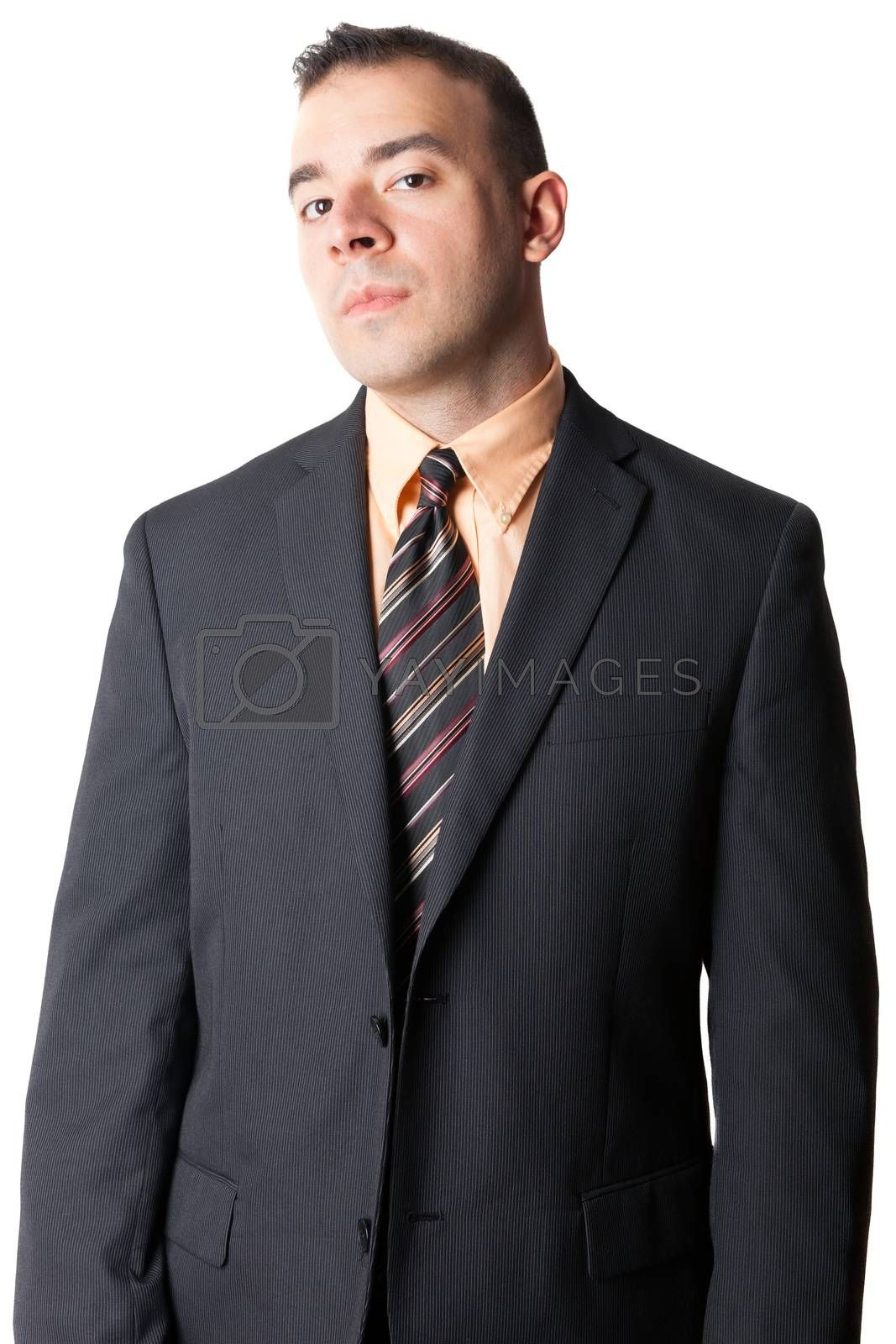 Serious business man in a black suit isolated over a white background.
