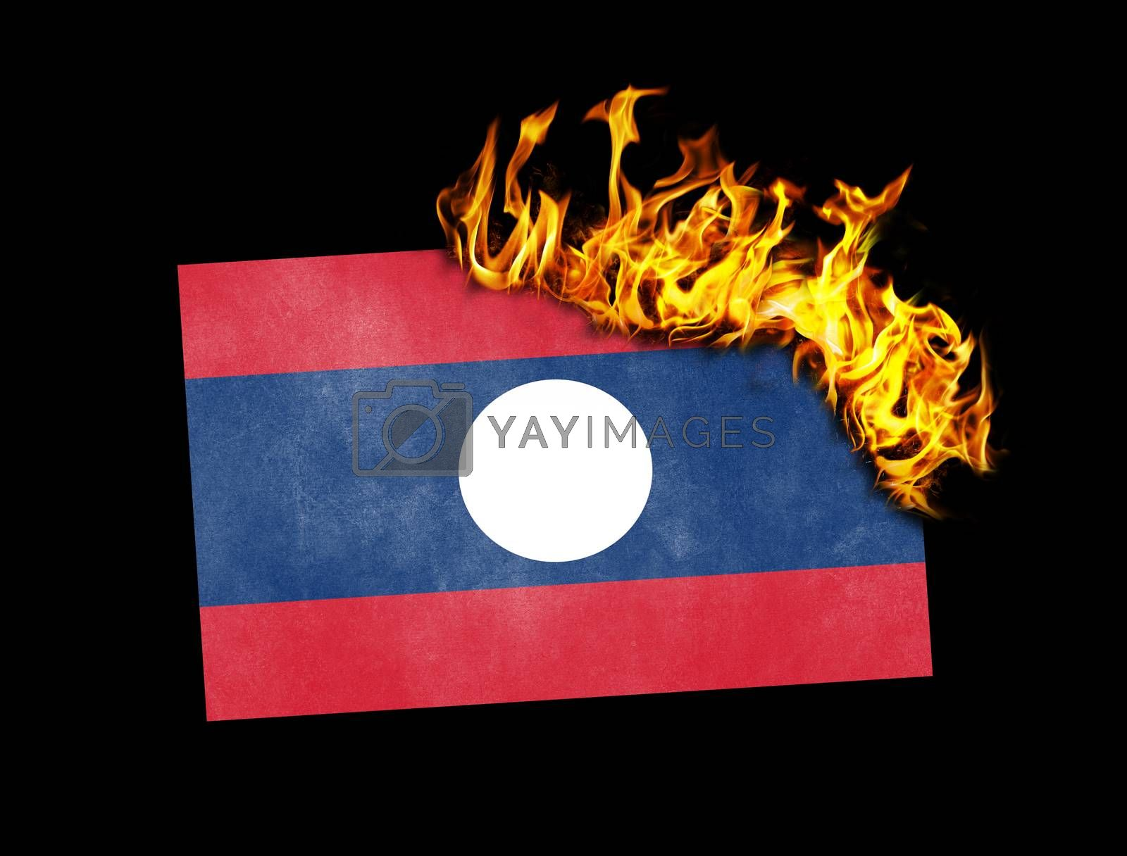 Royalty free image of Flag burning - Laos by michaklootwijk