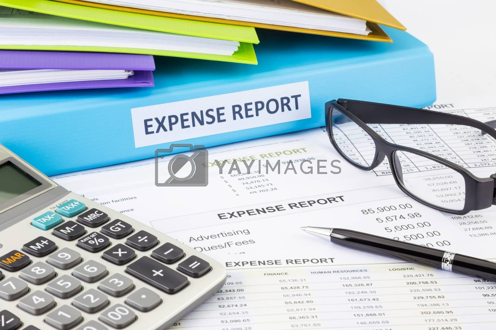 Business expense report binder with financial documents and calculator